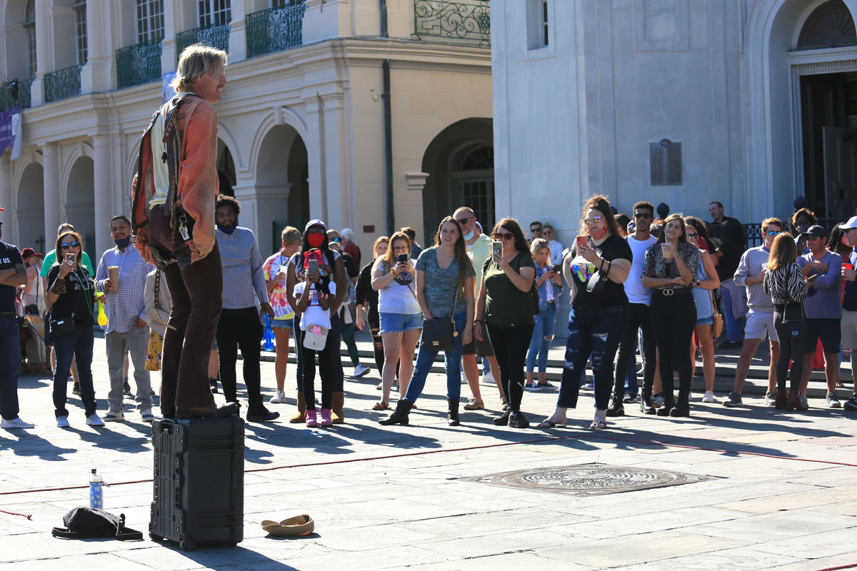 A street artist performs at New Orleans' French Quarter on Saturday, October 17, when the city eased restrictions on bars and restaurants.