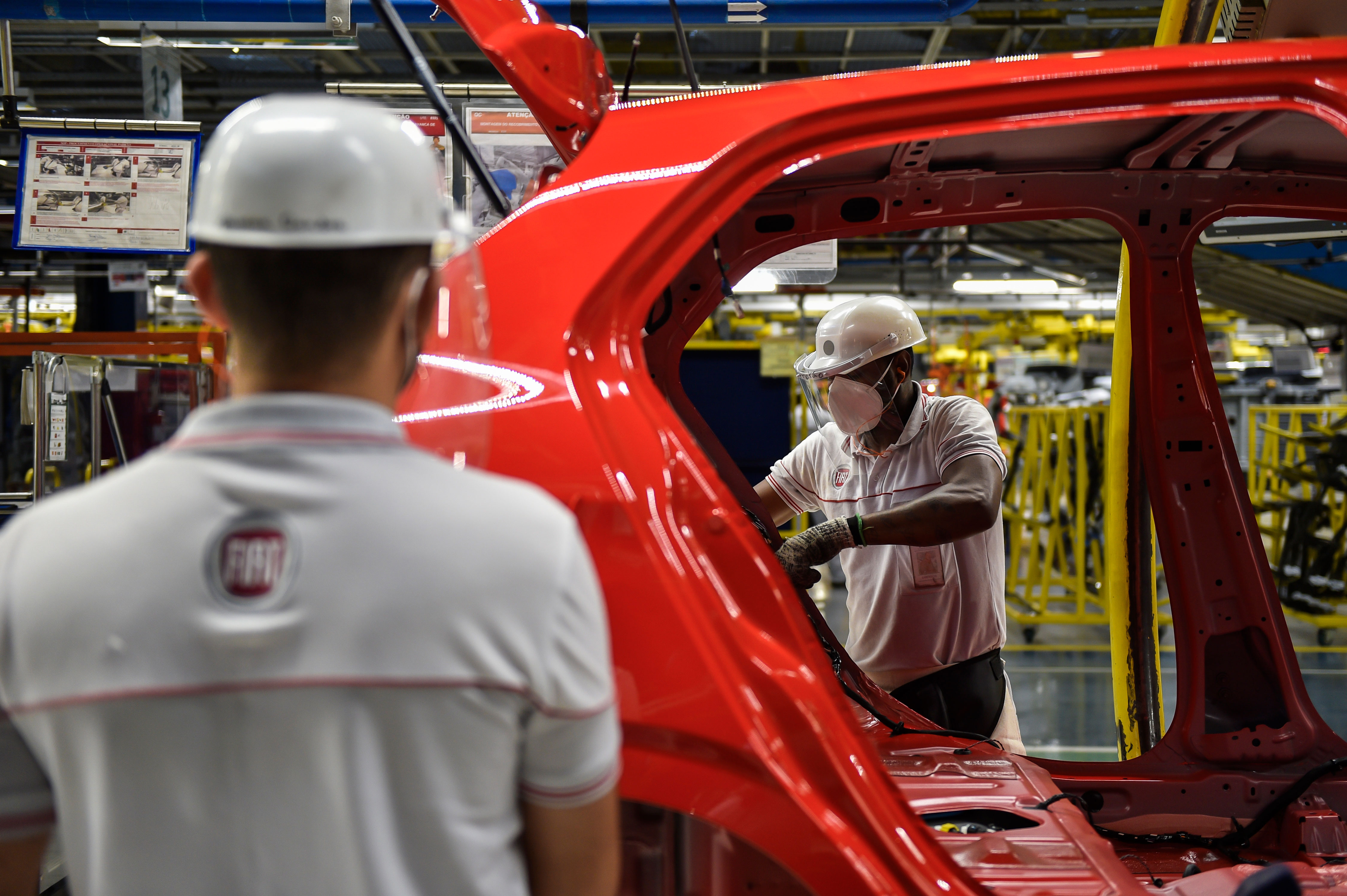 Employees work at the Fiat Chrysler Automobiles plant in Betim, Brazil, on June 10.