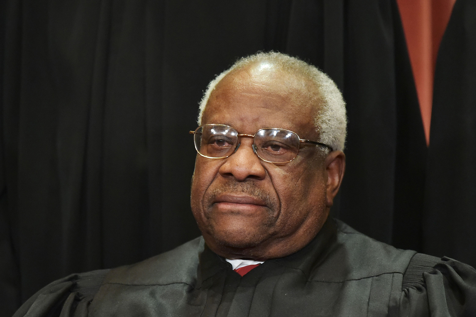 Associate Justice Clarence Thomas poses for the official group photo at the US Supreme Court in Washington, on November 30, 2018.