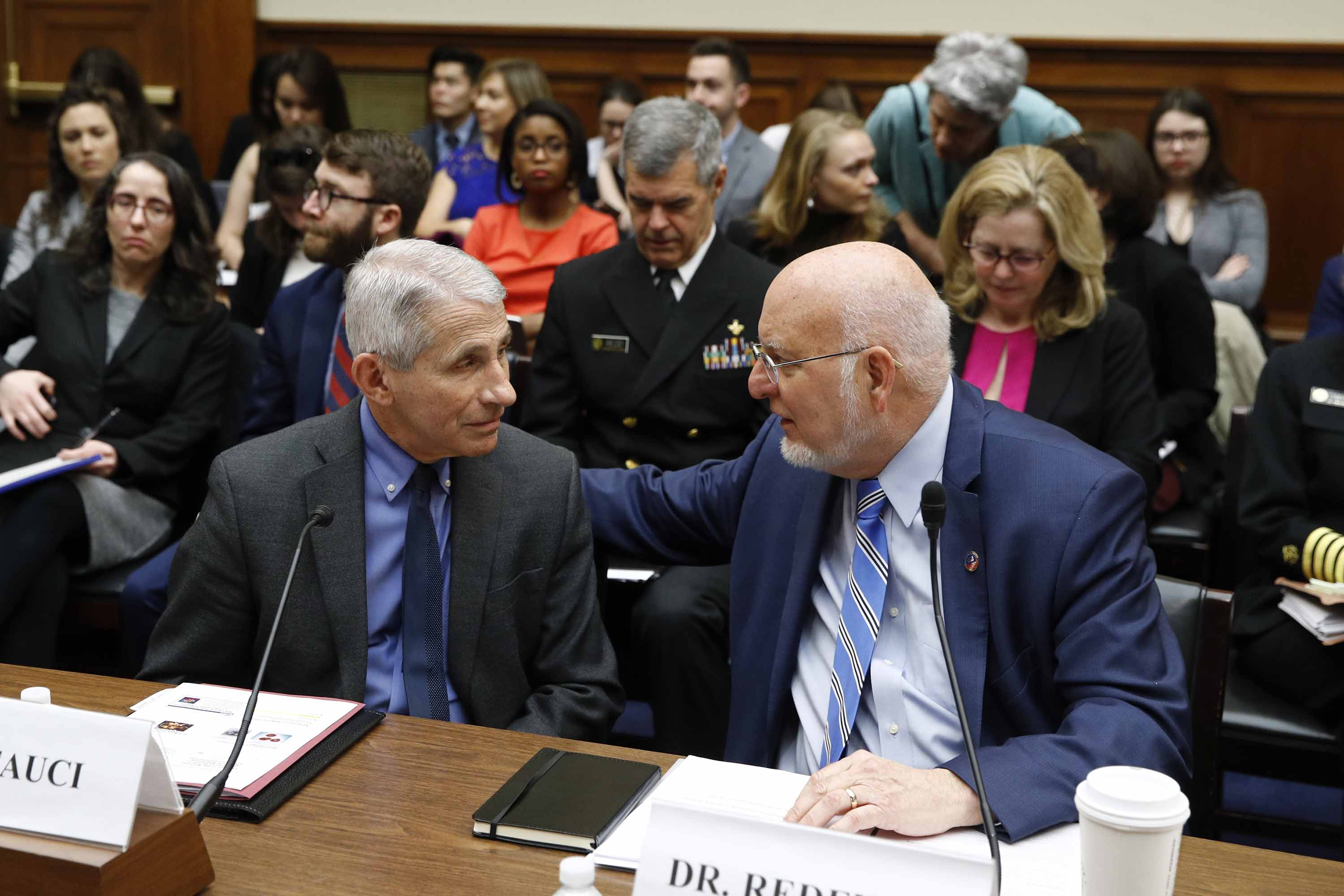 Dr. Anthony Fauci, left, director of the National Institute of Allergy and Infectious Diseases, speaks with Dr. Robert Redfield, director of the Centers for Disease Control and Prevention, before testifying at a House Oversight Committee hearing on the coronavirus outbreak in Washington, D.C. on Wednesday.
