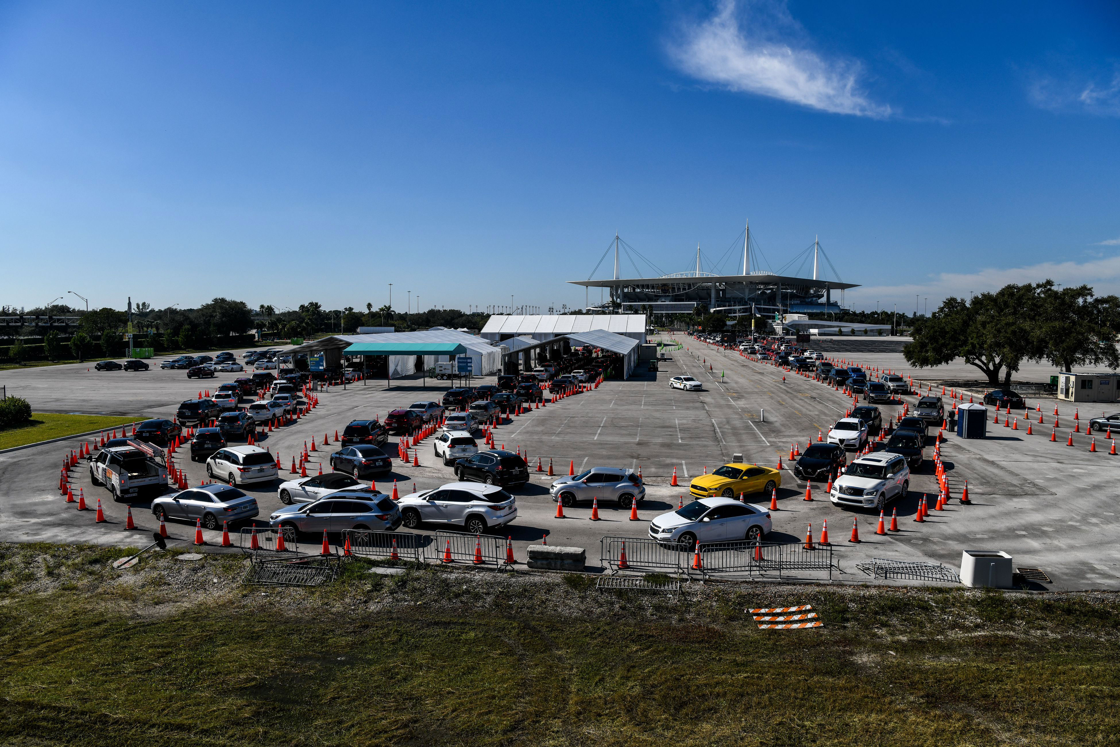 People in cars line up at a Covid-19 testing site in Miami on December 10.
