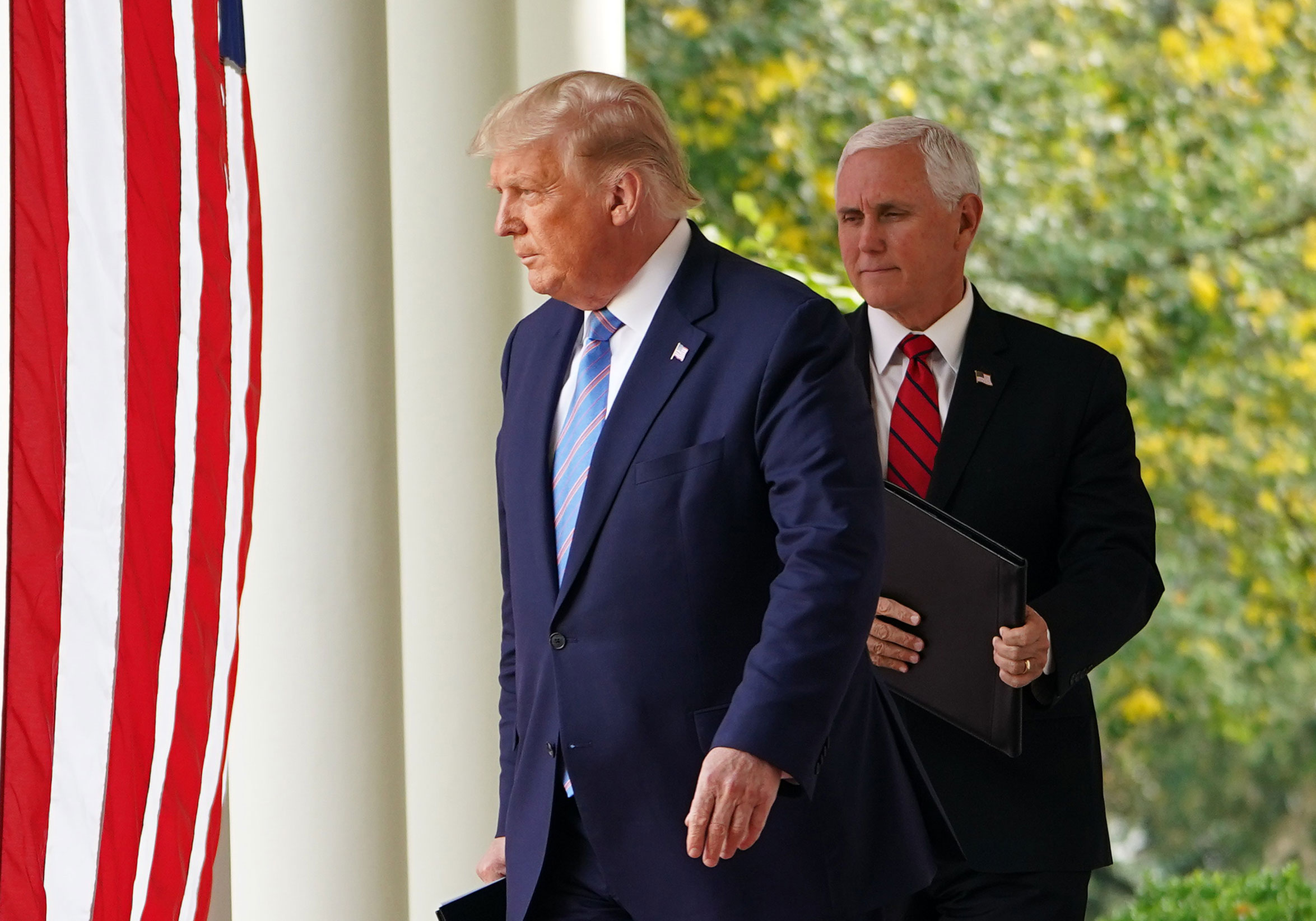President Donald Trump and Vice President Mike Pence arrive to speak on Covid-19 testing in the Rose Garden of the White House on September 28.