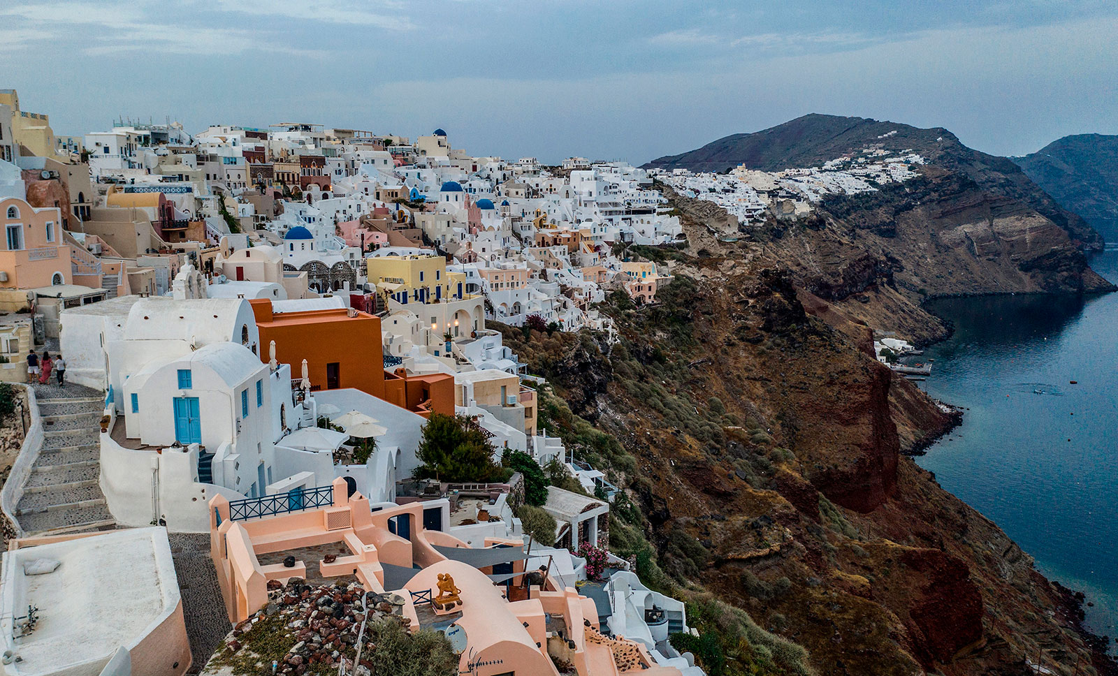 The village of Oia on the northwestern tip of the Greek island of Santorini on May 20. Greek Foreign Minister Nikos Dendias said that the gradual easing of restrictions should be completed by the end of June and expressed hope that Italians would choose Greece as their holiday destination.