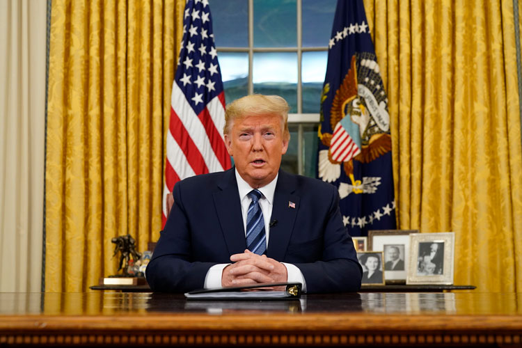 President Donald Trump speaks in an address to the nation from the Oval Office at the White House about the coronavirus Wednesday, March, 11, in Washington.