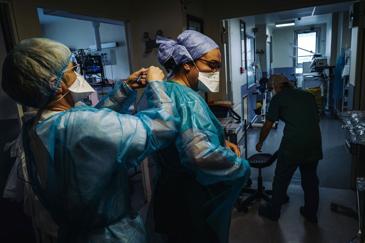 A nurse gets ready to enter a room to take care of a patient infected with COVID-19 at the intensive care unit of the Lariboisiere Hospital in Paris, on October 14.