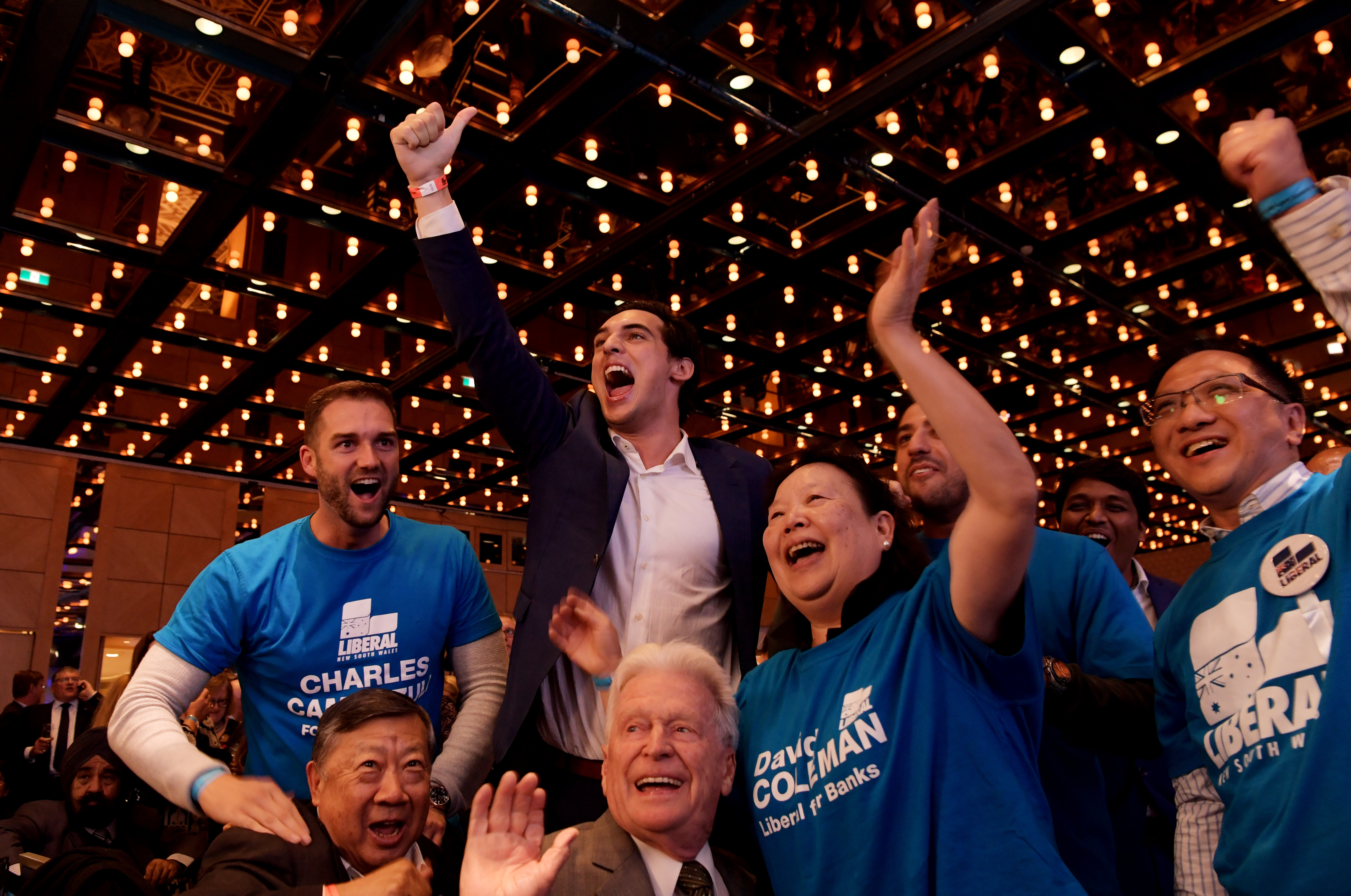 Scott Morrison supporters celebrate at the coalition's election party in Sydney on May 18.