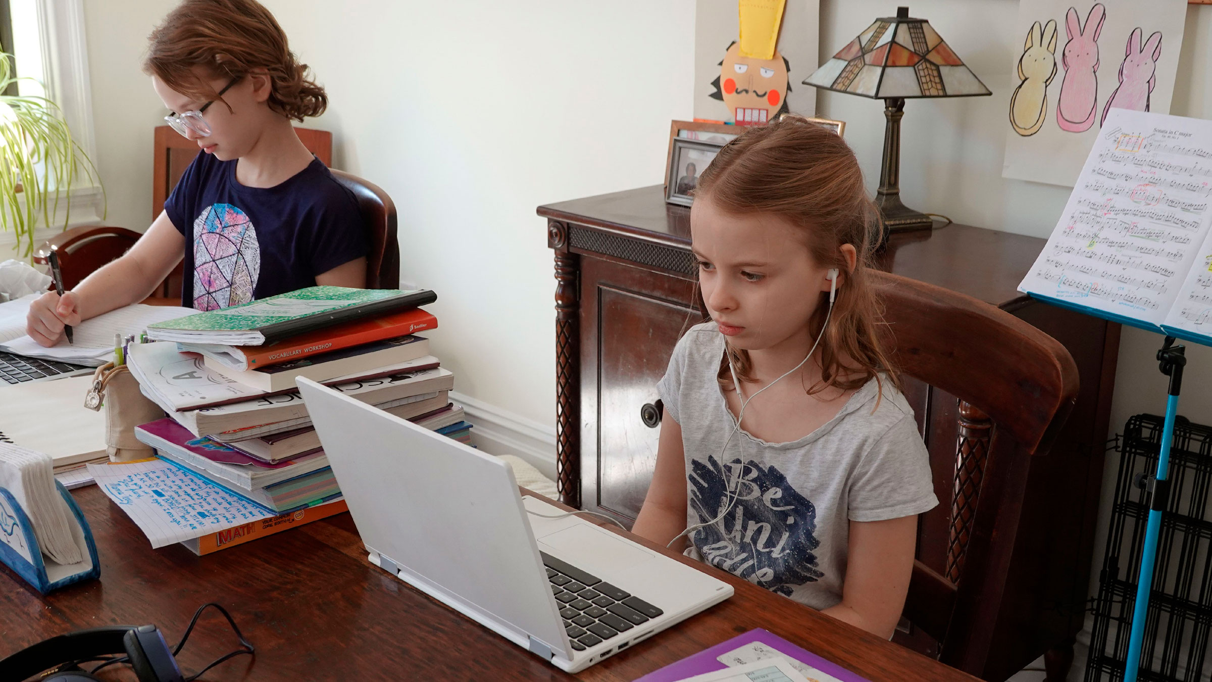Children in New York do their schoolwork from home in April.