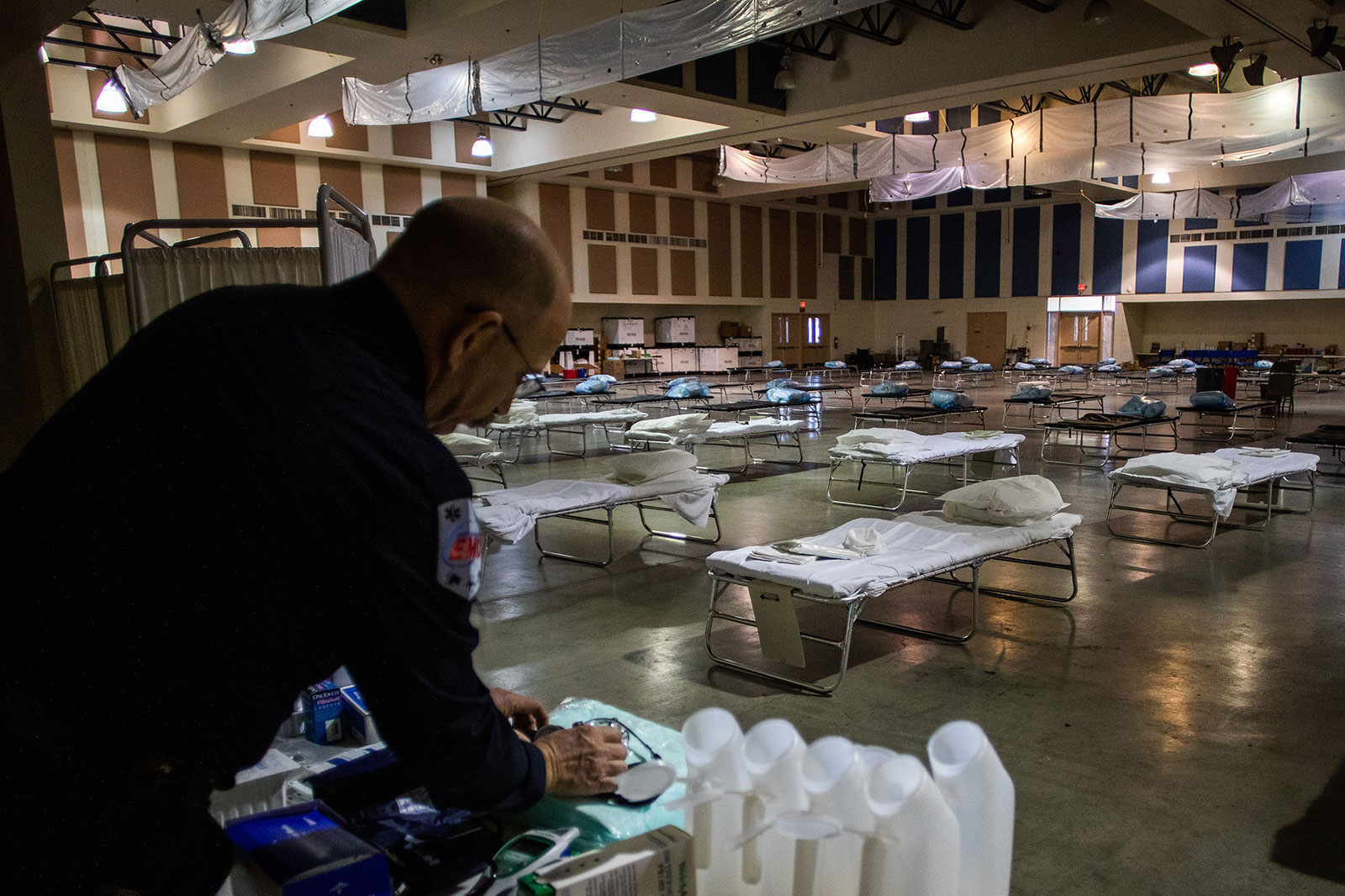 Health Public Information Officer Shane Reichardt organizes medical equipment inside a field hospital in Indio, California, on March 29.