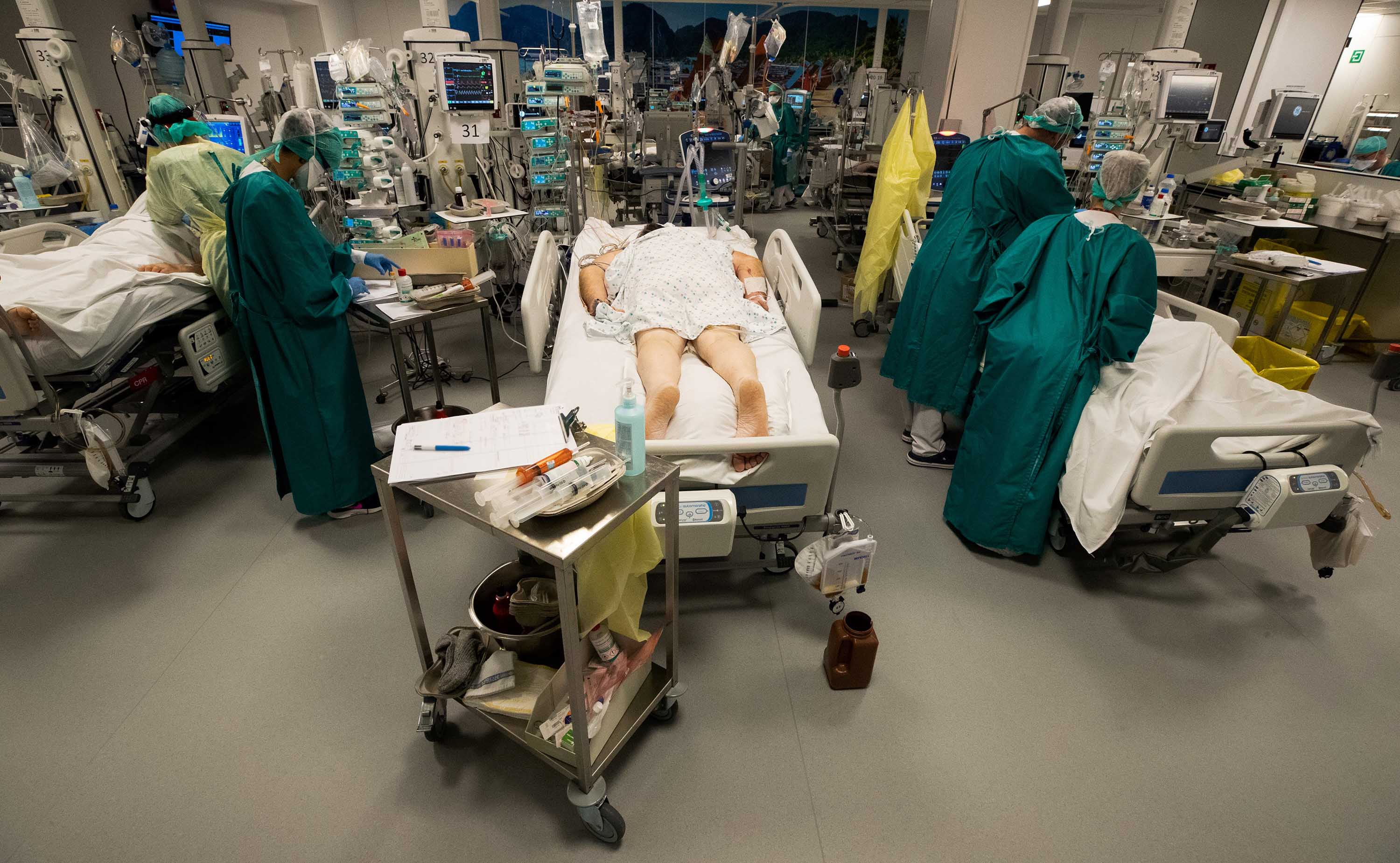 Medical staff members treat patients in the Covid-19 unit at a hospital in Liege, Belgium, on October 29.