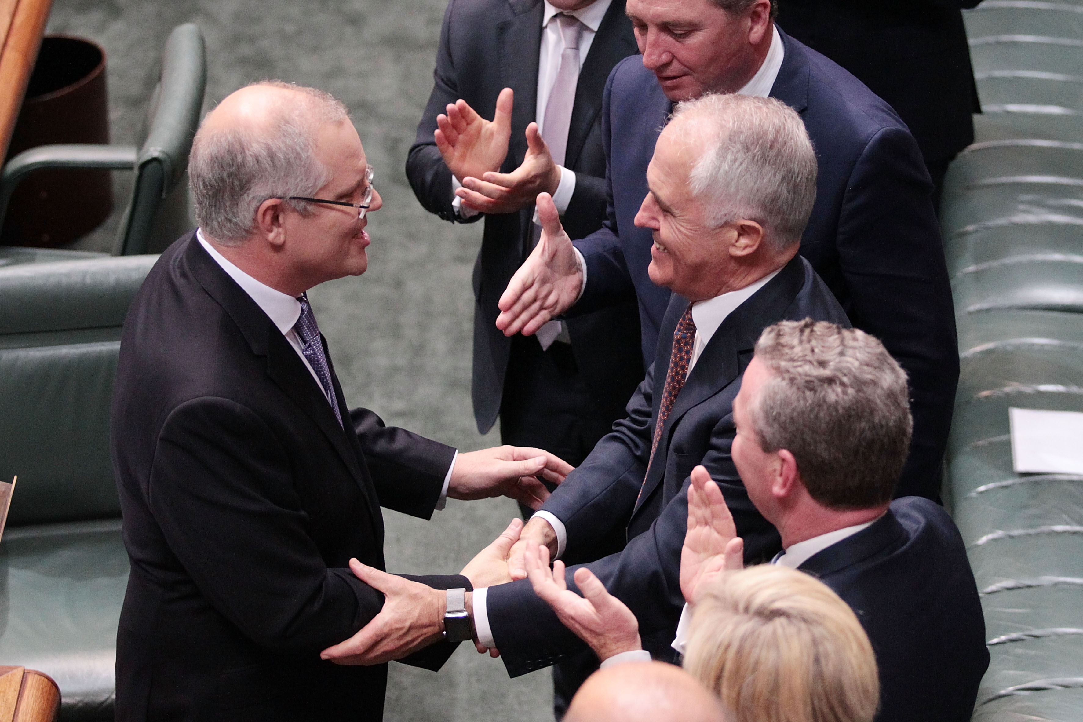 Then-treasurer Scott Morrison is congratulated by Prime Minister Malcolm Turnbull after delivering the budget in the House of Representatives in 2017.