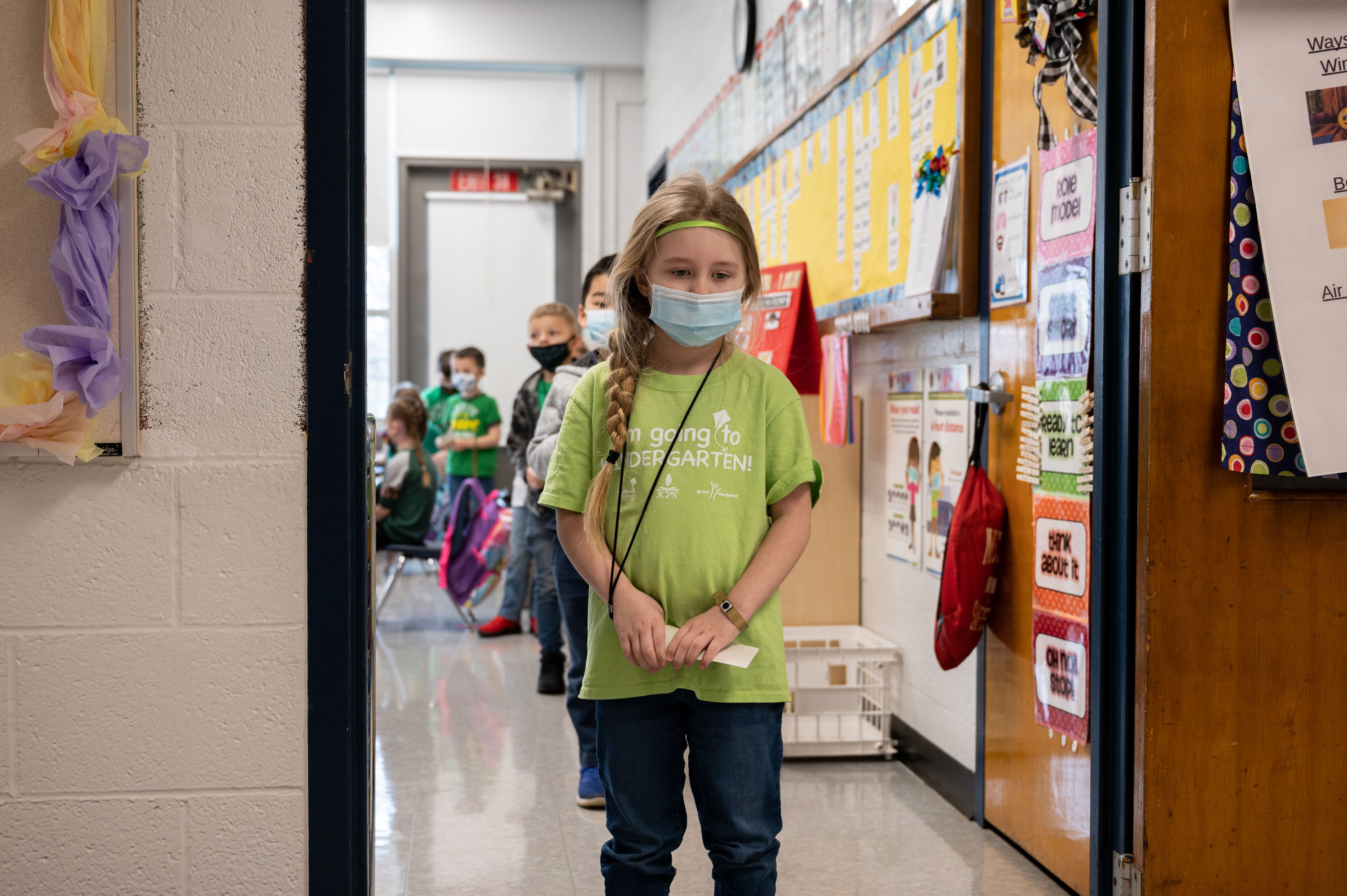 Students wait in a socially distanced single file line at Medora Elementary School on March 17 in Louisville, Kentucky.