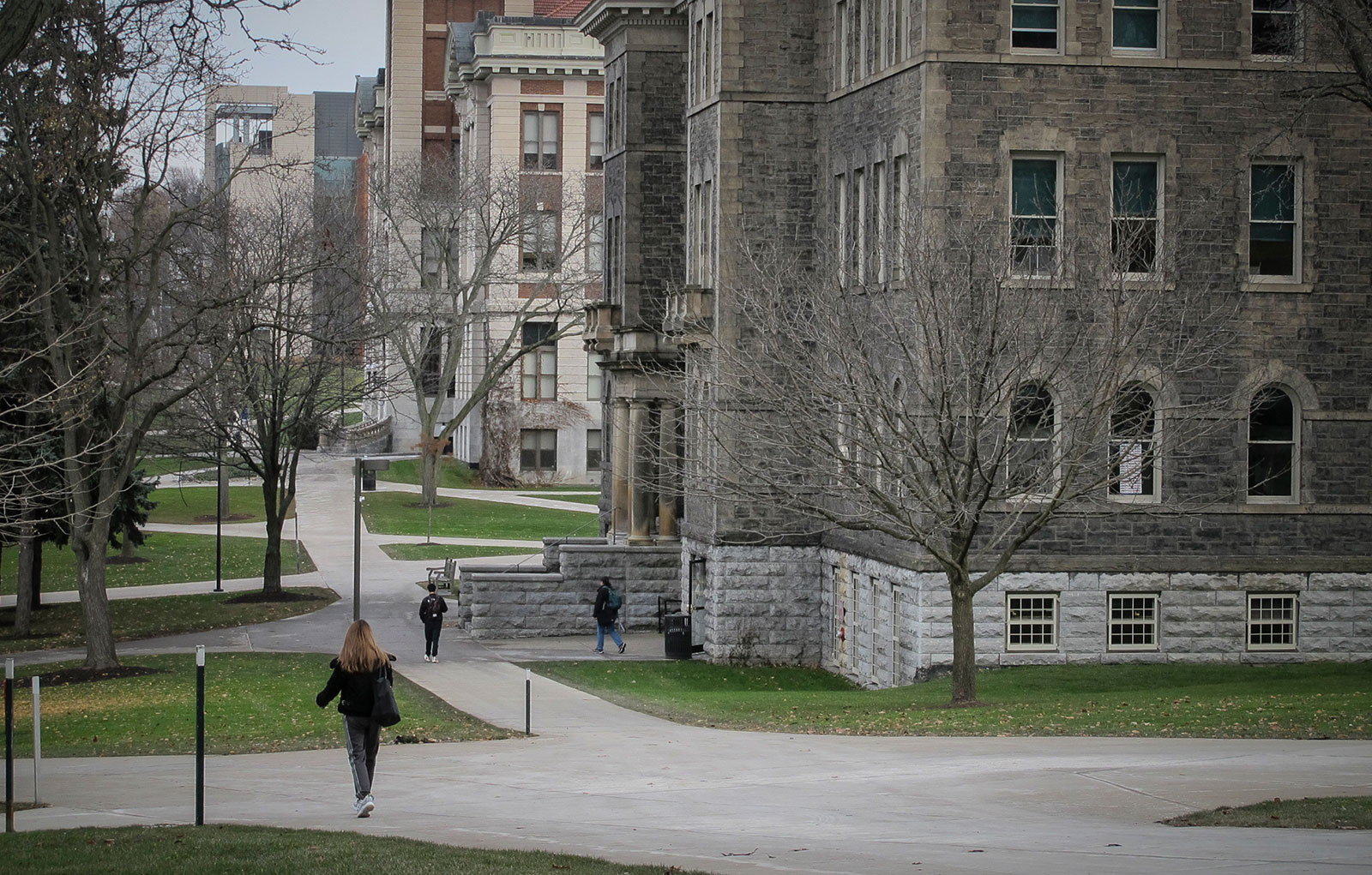 In this 2019 file photo, students walk through the Syracuse University campus.