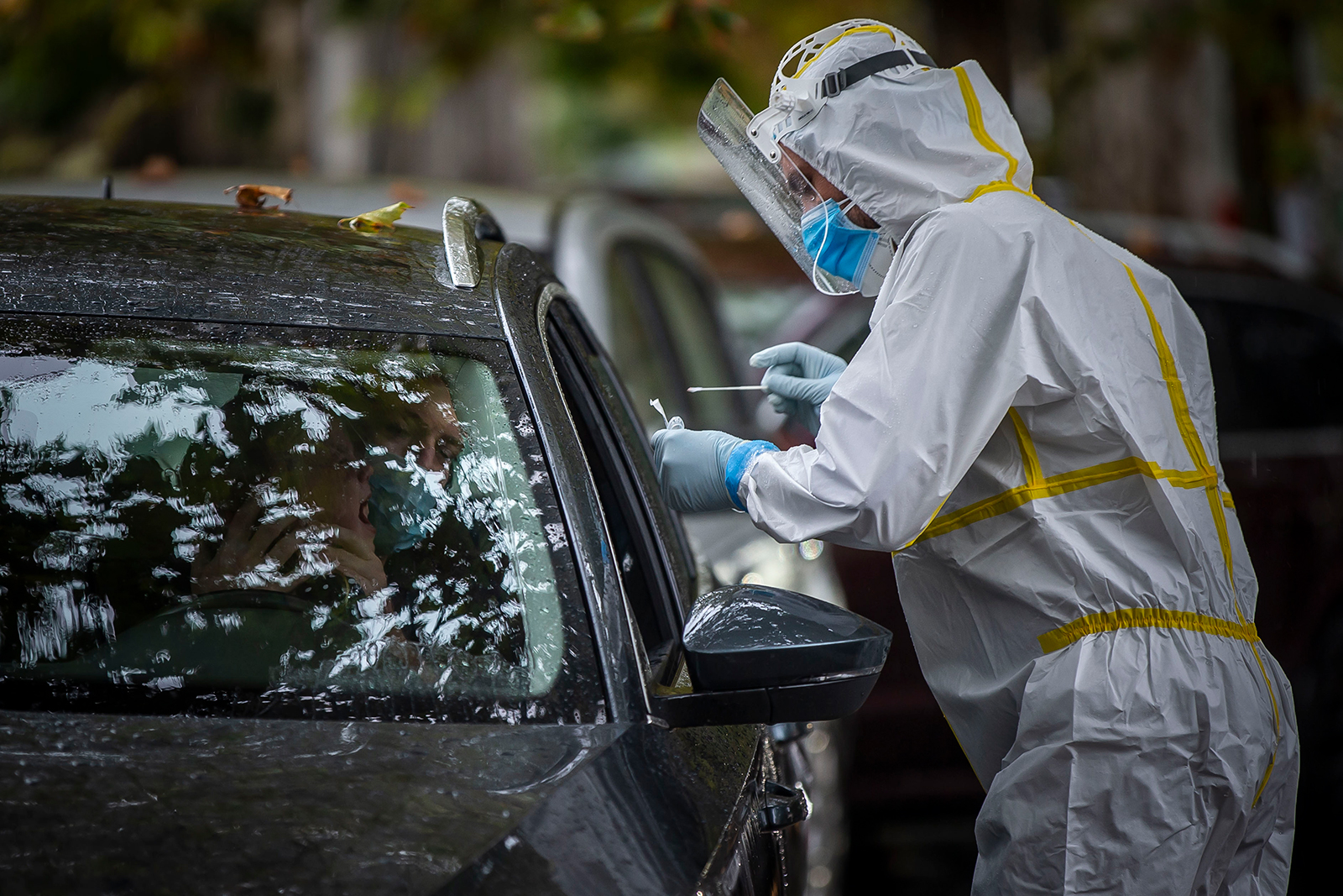 A healthcare worker conducts a Covid-19 test at a drive-in testing station in Prague, Czech Republic, on October 10.