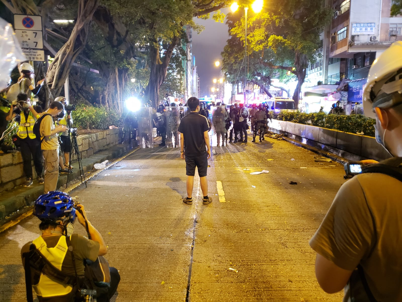 Democratic politician Ted Hui stands before the police in Kowloon.