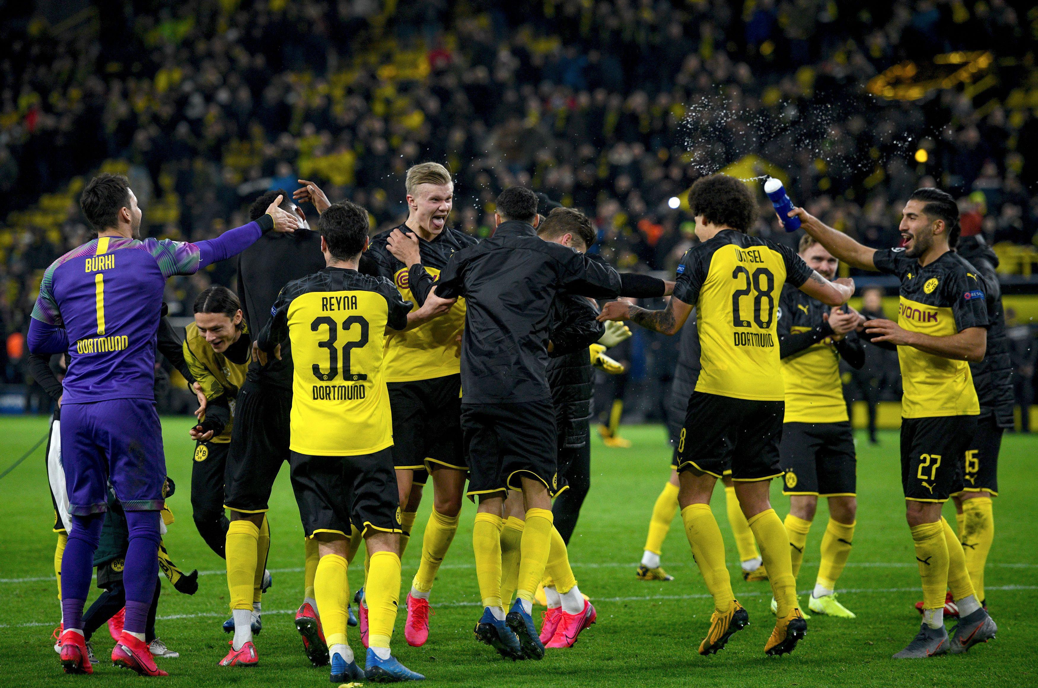 Borussia Dortmund players celebrate at full time.