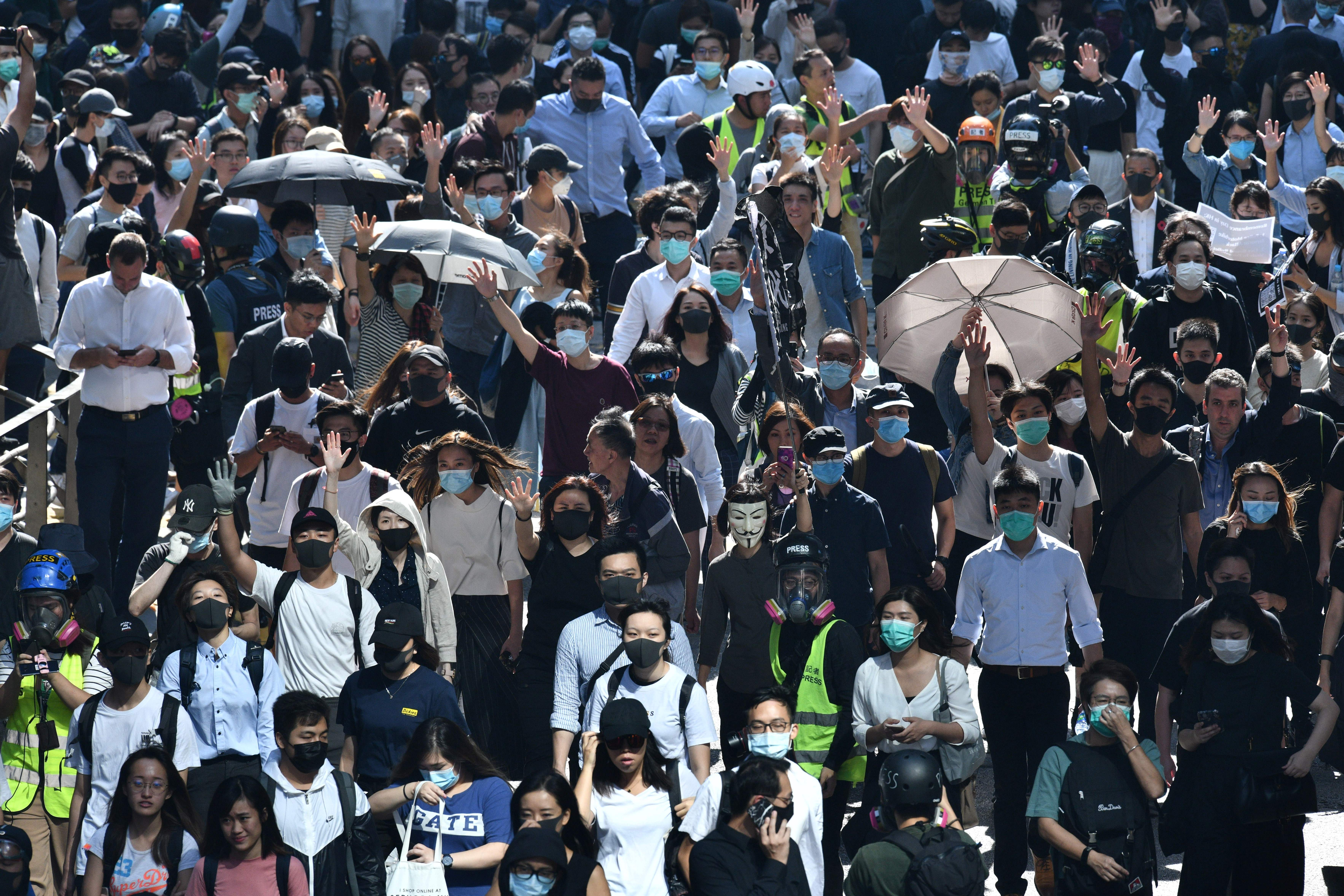 Demonstrators march in Hong Kong's Central district on November 11, 2019.