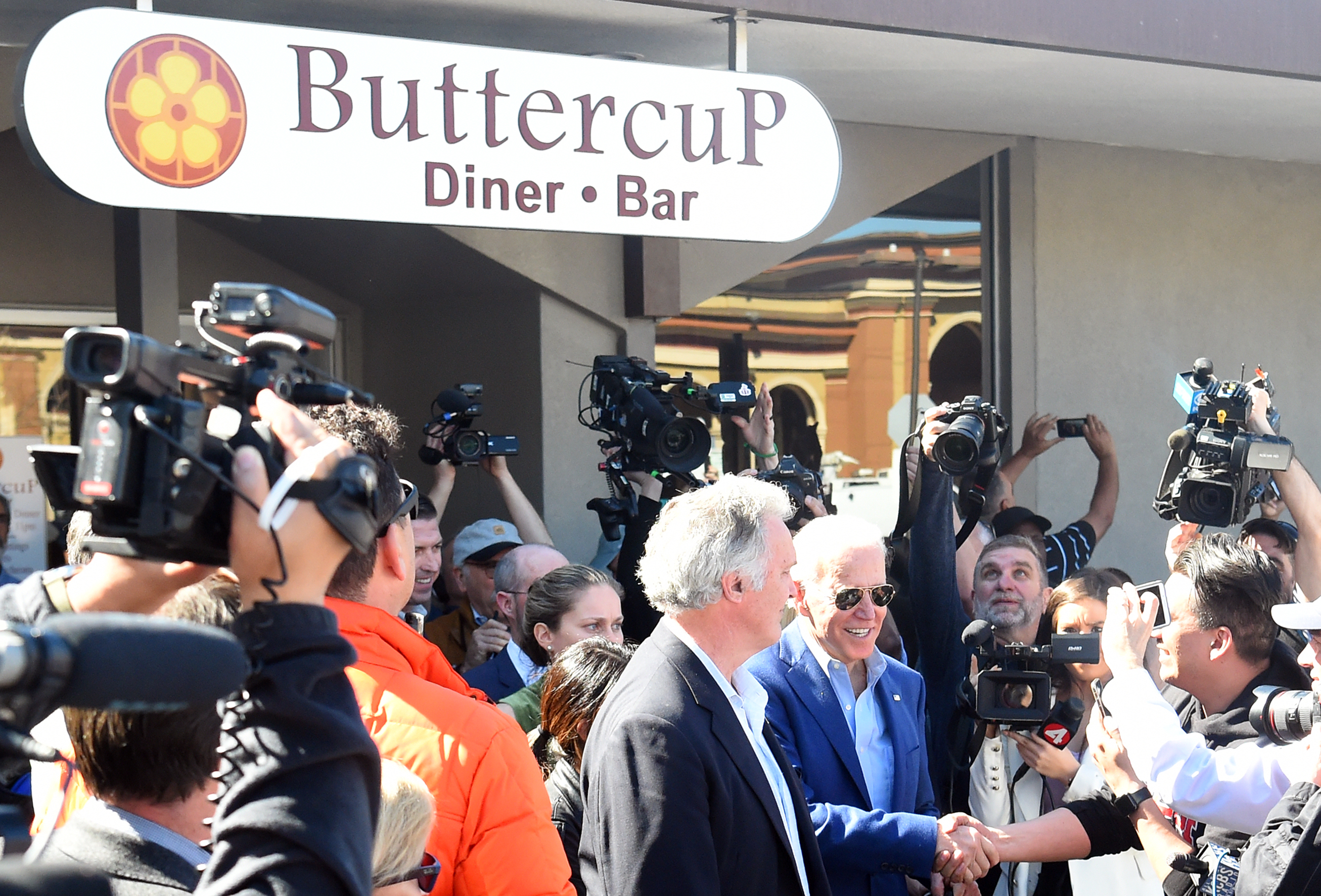 Democratic presidential candidate Joe Biden greets members of the media at Buttercup Diner in Oakland, California.