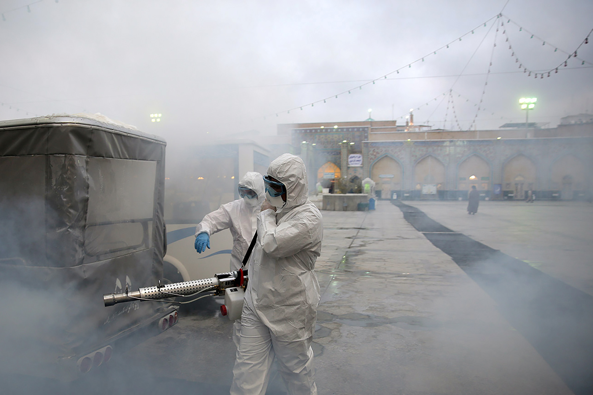 Members of a medical team spray disinfectant to sanitize around Imam Reza's holy shrine, following the coronavirus outbreak, in Mashhad, Iran February 27.