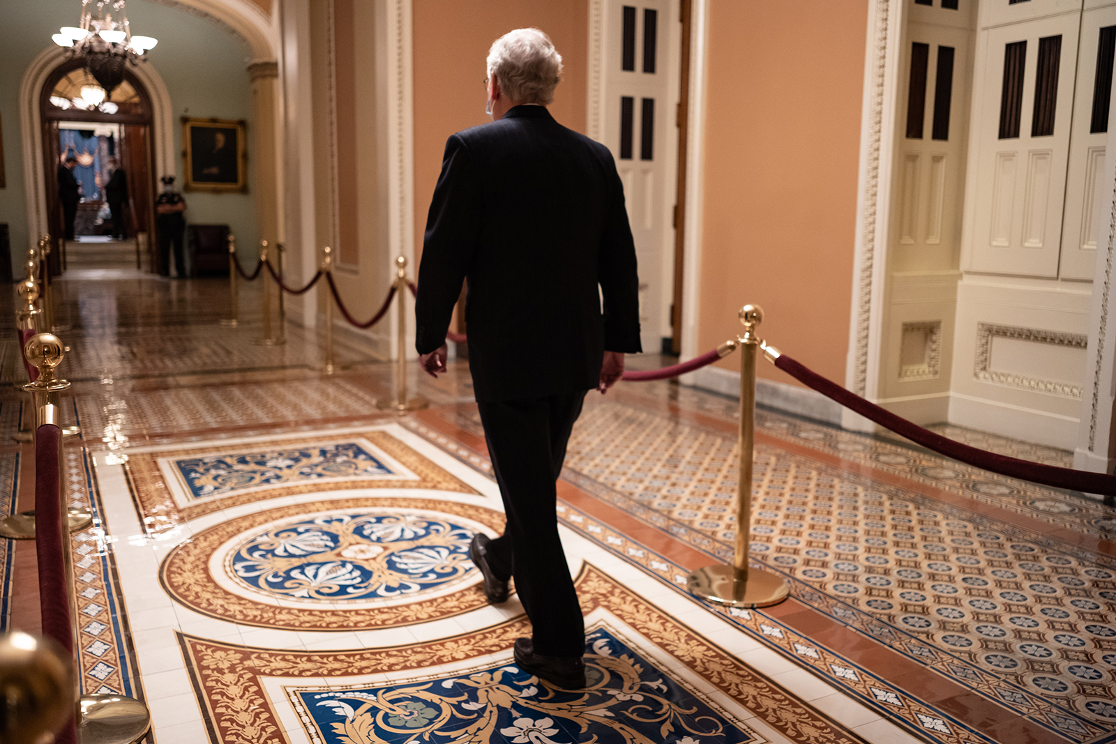 Senate Majority Leader Mitch McConnell walks to the Senate Floor at the US Capitol on December 21, in Washington, DC.