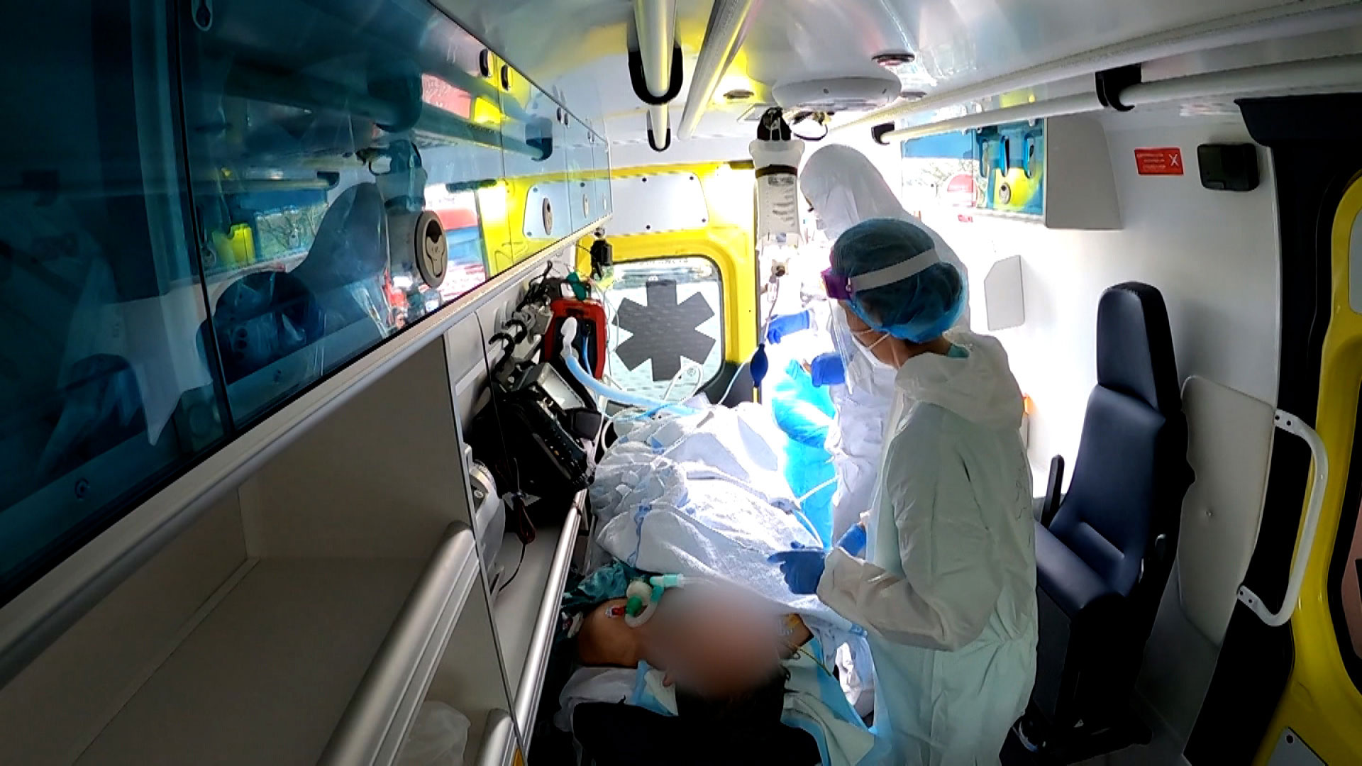 Ambulance workers in Portugal transport a Covid-19 patient.