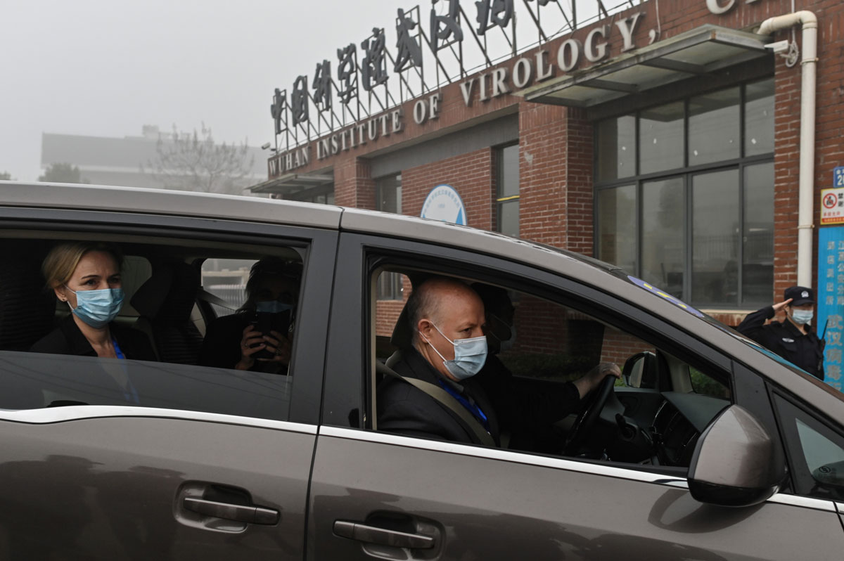 Peter Daszak (r) and other members of the World Health Organization team investigating the origins of the Covid-19 coronavirus, arrive at the Wuhan Institute of Virology on February 3.