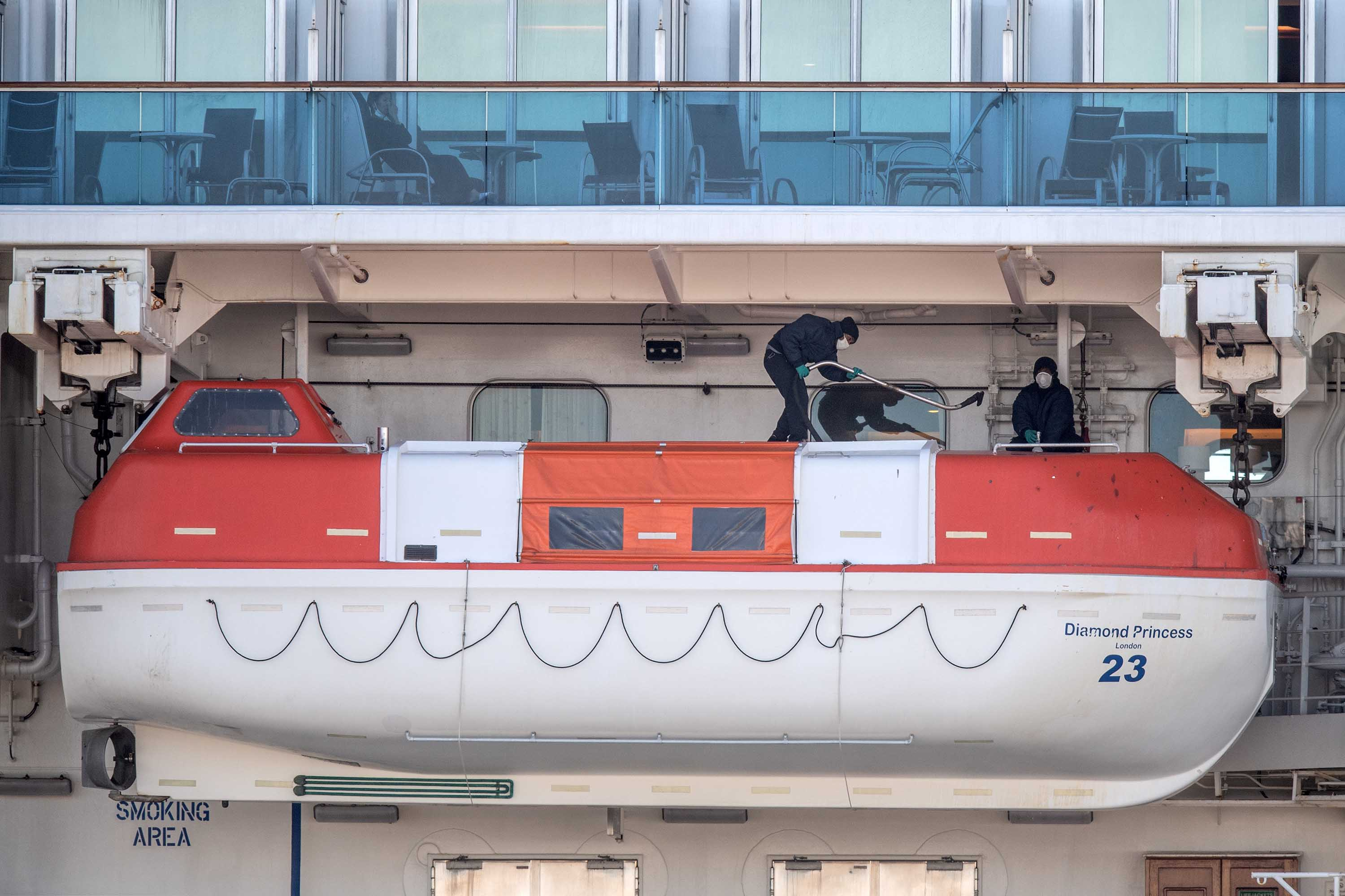 Crew members carry out maintenance on the Diamond Princess cruise ship docked in Yokohama, Japan on February 11.