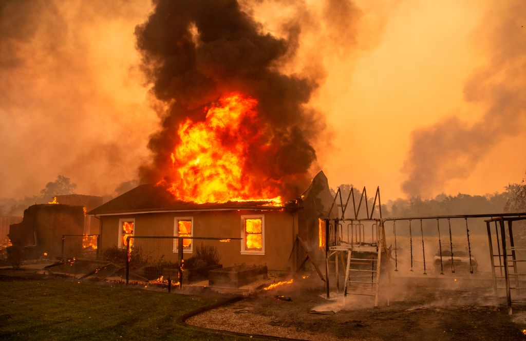 A home burns at a vineyard during the Kincade fire near Geyserville, California on October 24, 2019.