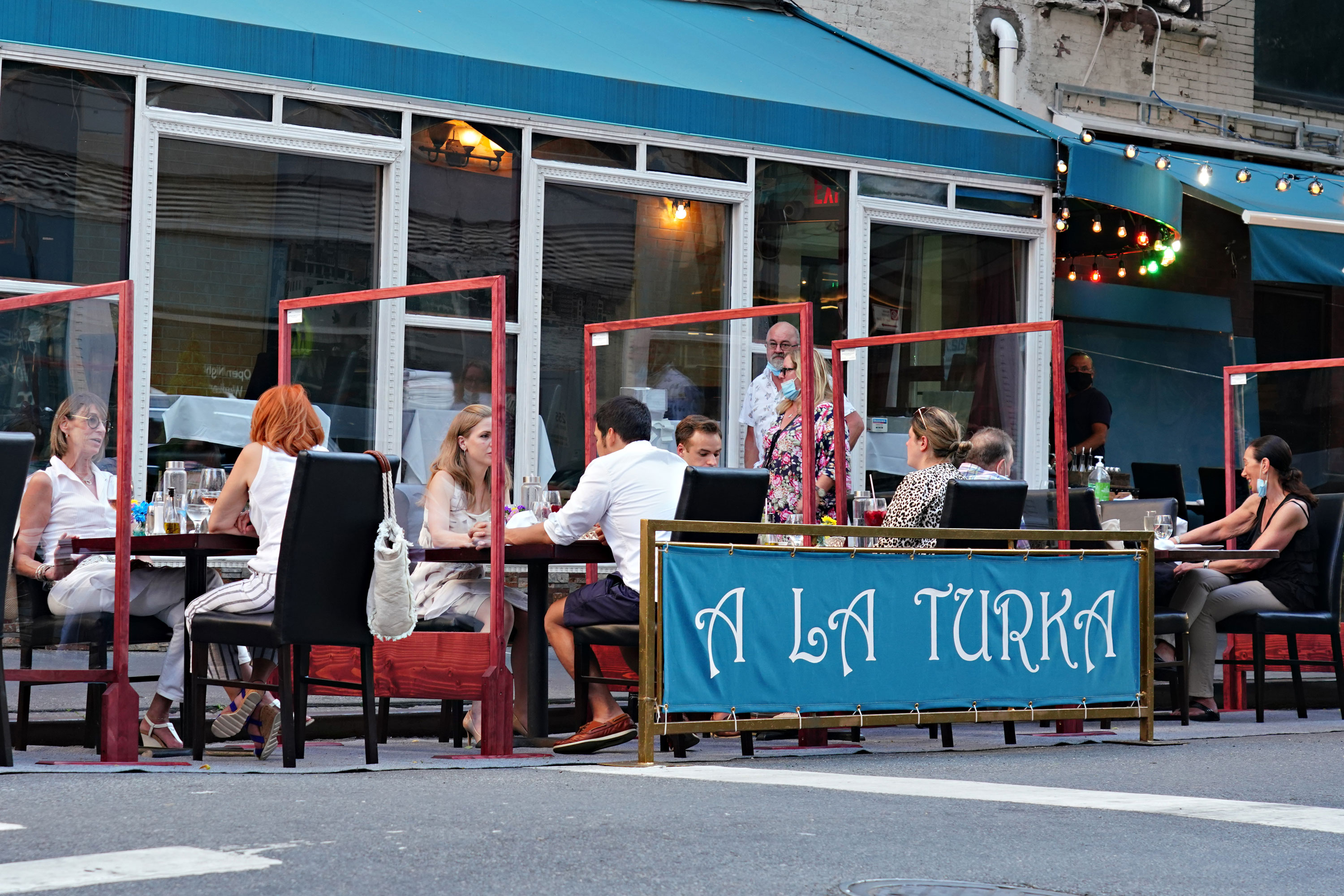 People in New York dine outside on June 24.