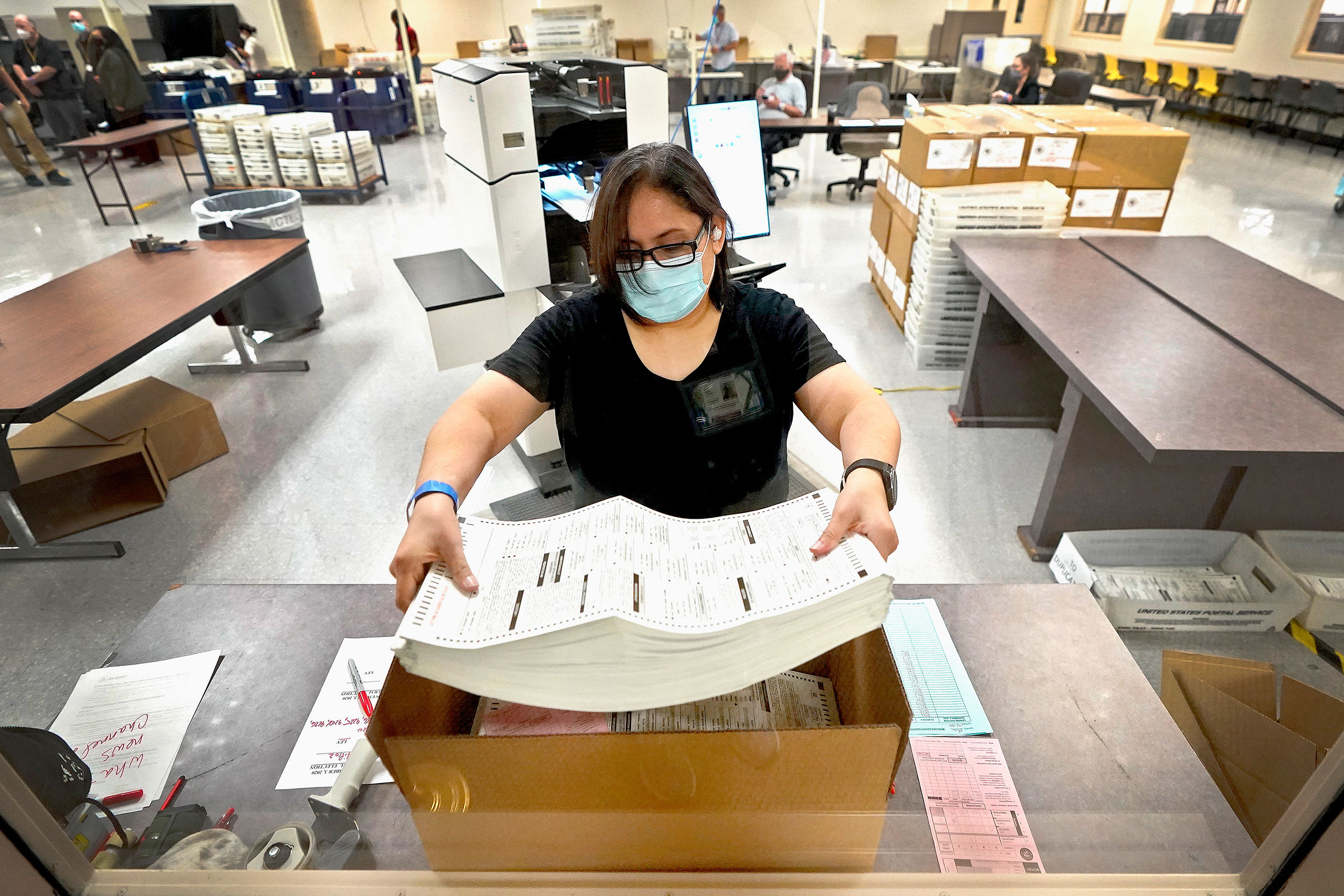 An election official counts ballots inside the Maricopa County Recorder's Office on November 6 in Phoenix, Arizona.