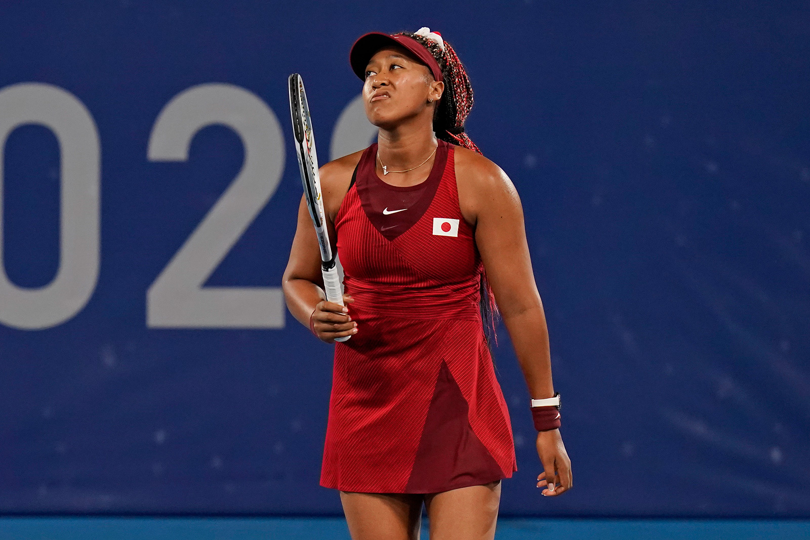 Japan's Naomi Osaka, of Japan reacts after losing a point to Marketa Vondrousova, of the Czech Republic, during a tennis match on Tuesday.