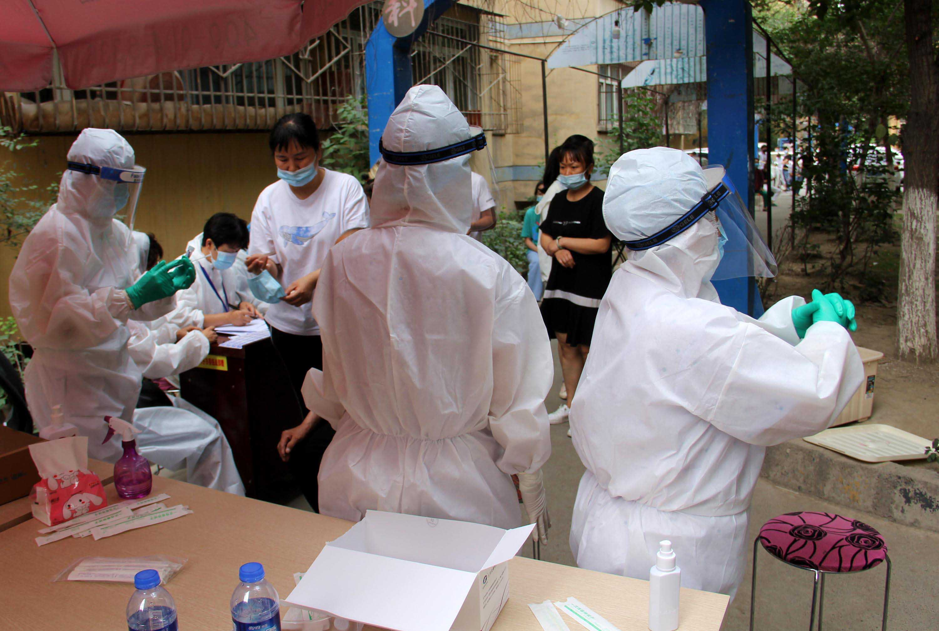 Residents undergo nucleic acid testing in Urumqi, in the Xinjiang Uyghur Autonomous Region of China, on July 19.