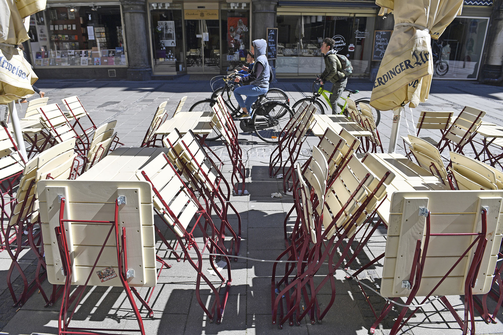 Empty tables and chairs are seen outside of a Bavarian restaurant, closed due to the coronavirus pandemic, in Munich, Germany, on April 5.
