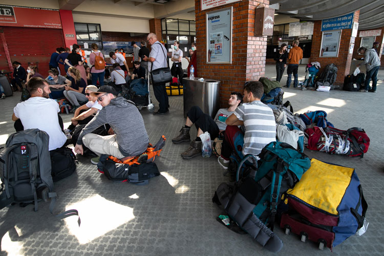 Tourists from Germany who have been stranded in Nepal due to the government-imposed lock down amid concerns over the spread of coronavirus wait for their chartered flight back home at Tribhuvan International Airport in Kathmandu.