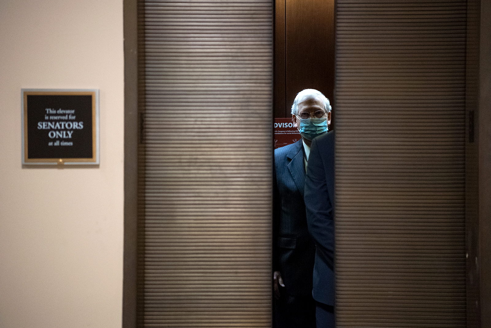 Senate Majority Leader Mitch McConnell, takes the elevator in the Hart Building in the Capitol in Washington, DC on July 1.