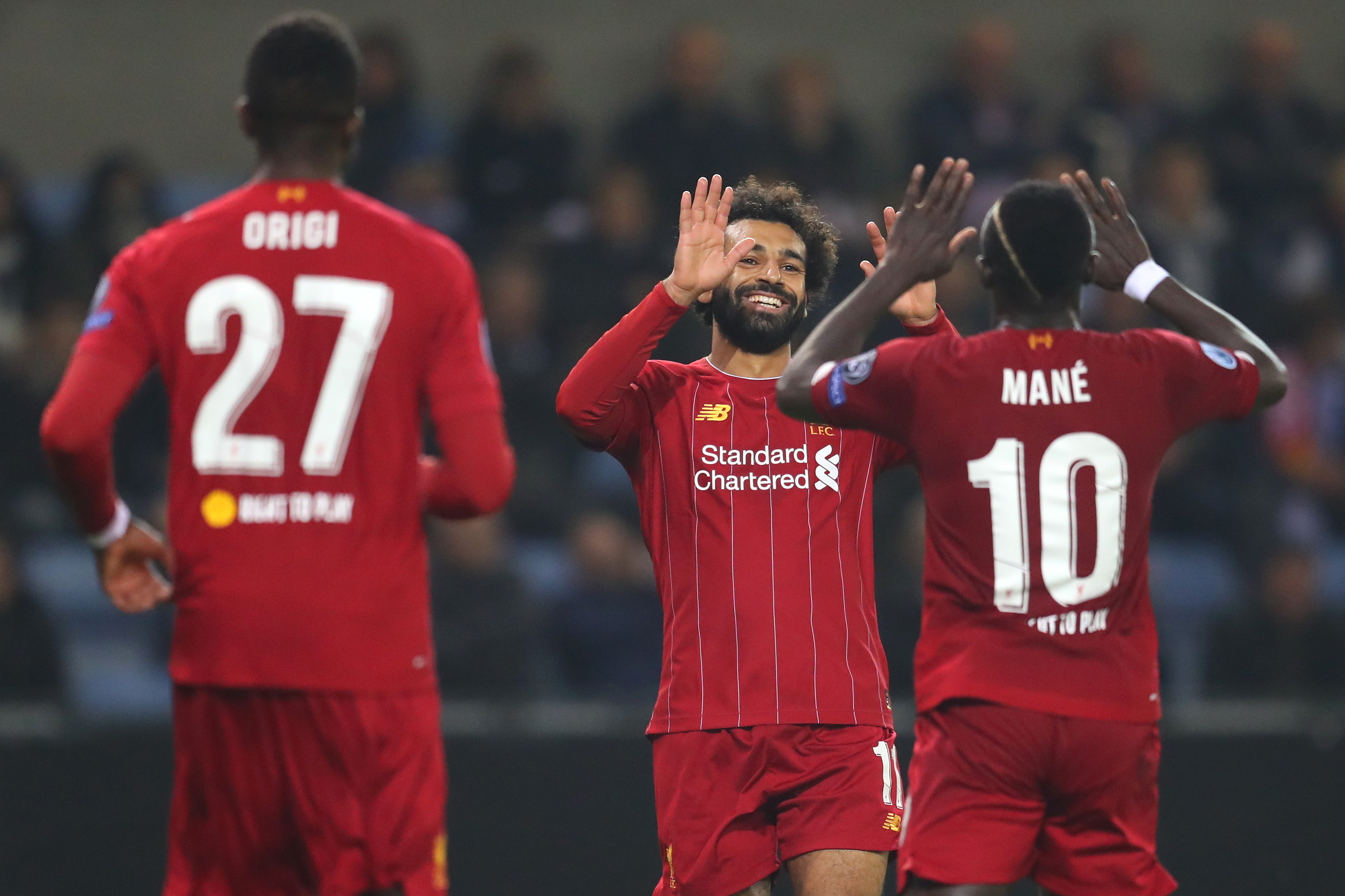 Mo Salah celebrates scoring Liverpool's fourth goal.