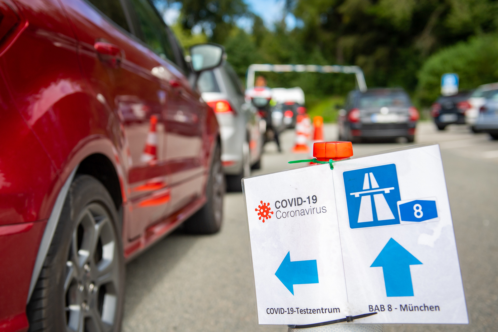 A testing center sign is pictured for vacation returnees at a rest stop on the A8 highway near Traunstein, Germany, on August 20.