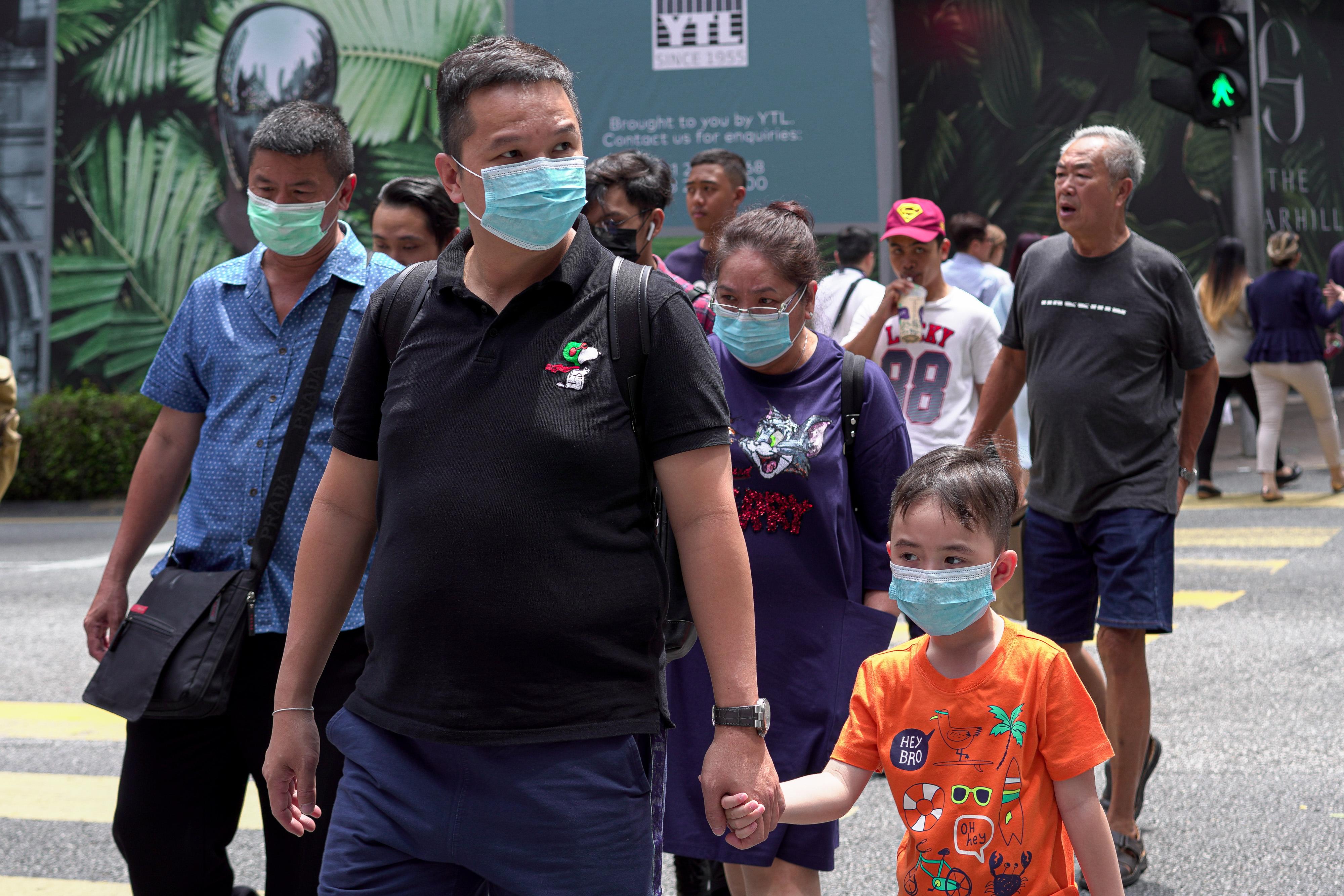 Visitors wearing masks on February 5, 2020 in Kuala Lumpur, Malaysia.