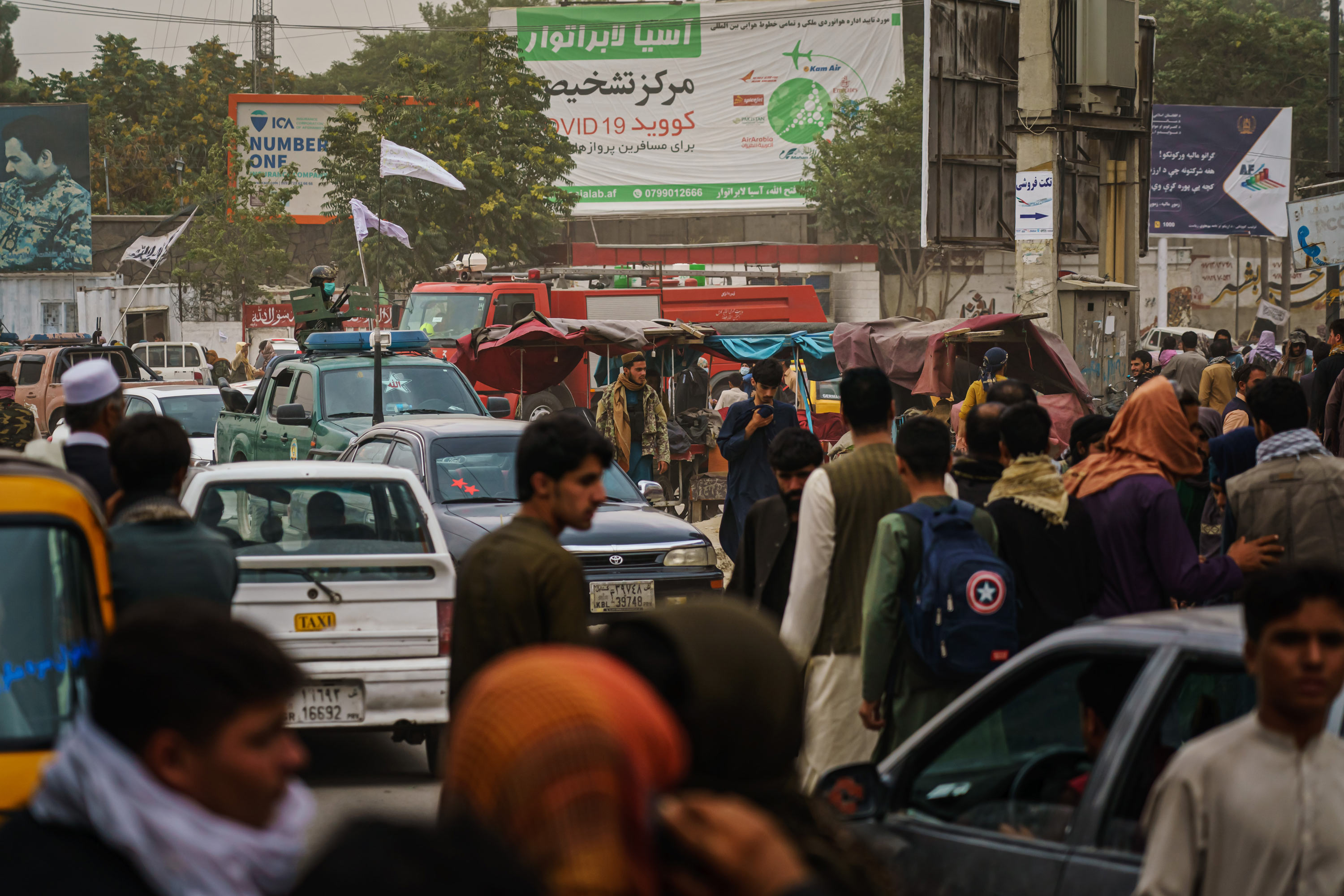 Afghans gather outside Kabul Airport on August 17.