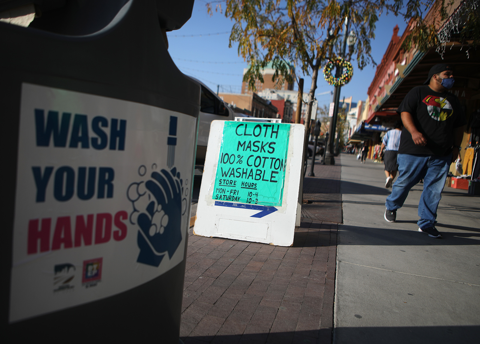 Masks are advertised near a handwashing station amid a surge of coronavirus cases in the city on November 18, in El Paso, Texas.
