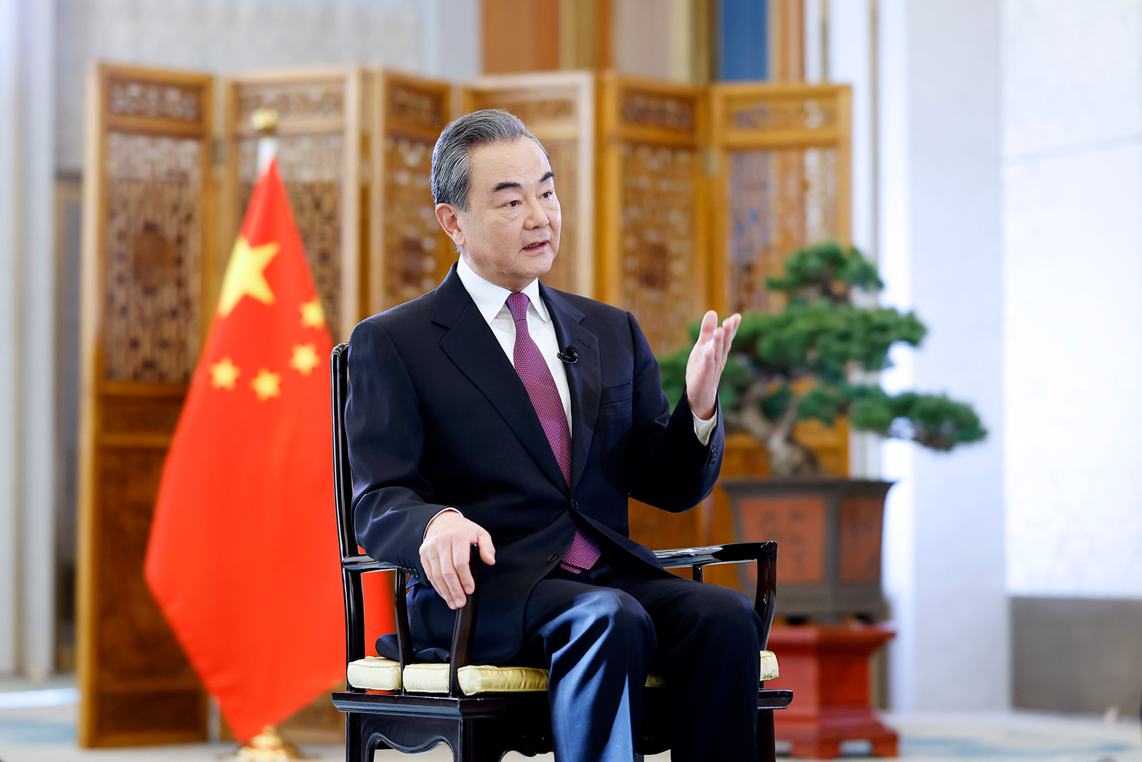 Chinese State Councilor and Foreign Minister Wang Yi is seen in a recent interview with Xinhua News Agency and China Media Group in Beijing, on December 31, 2020.