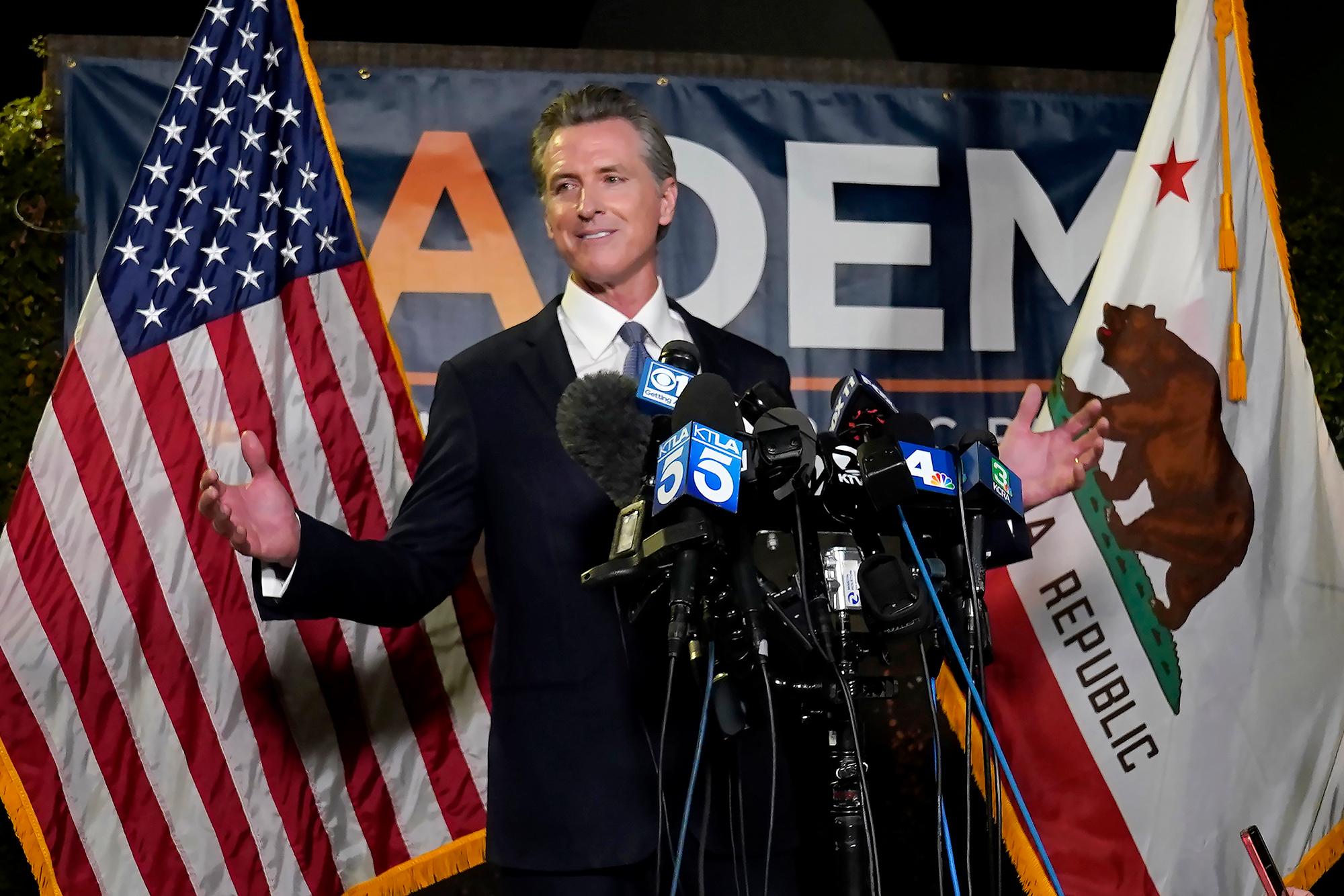 California Gov. Gavin Newsom addresses reporters after beating back the recall attempt that aimed to remove him from office at the John L. Burton California Democratic Party headquarters in Sacramento, on Tuesday.