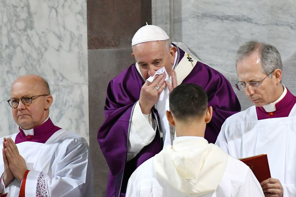 Pope Francis wipes his nose during the Ash Wednesday mass on February 26, 2020, at the Santa Sabina church in Rome.