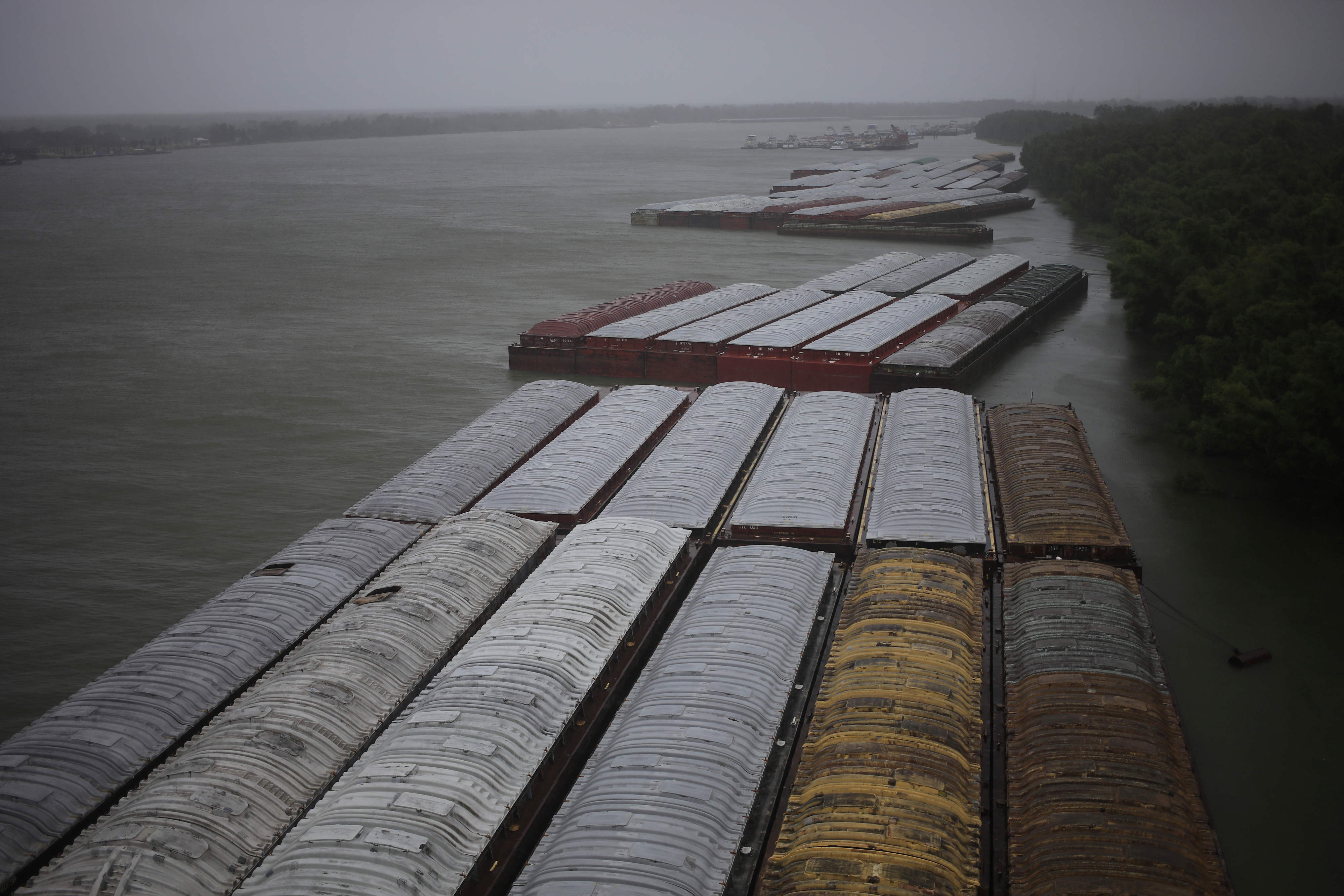 Barges are docked on the Mississippi River in Destrehan, Louisiana, on Sunday, August 29.