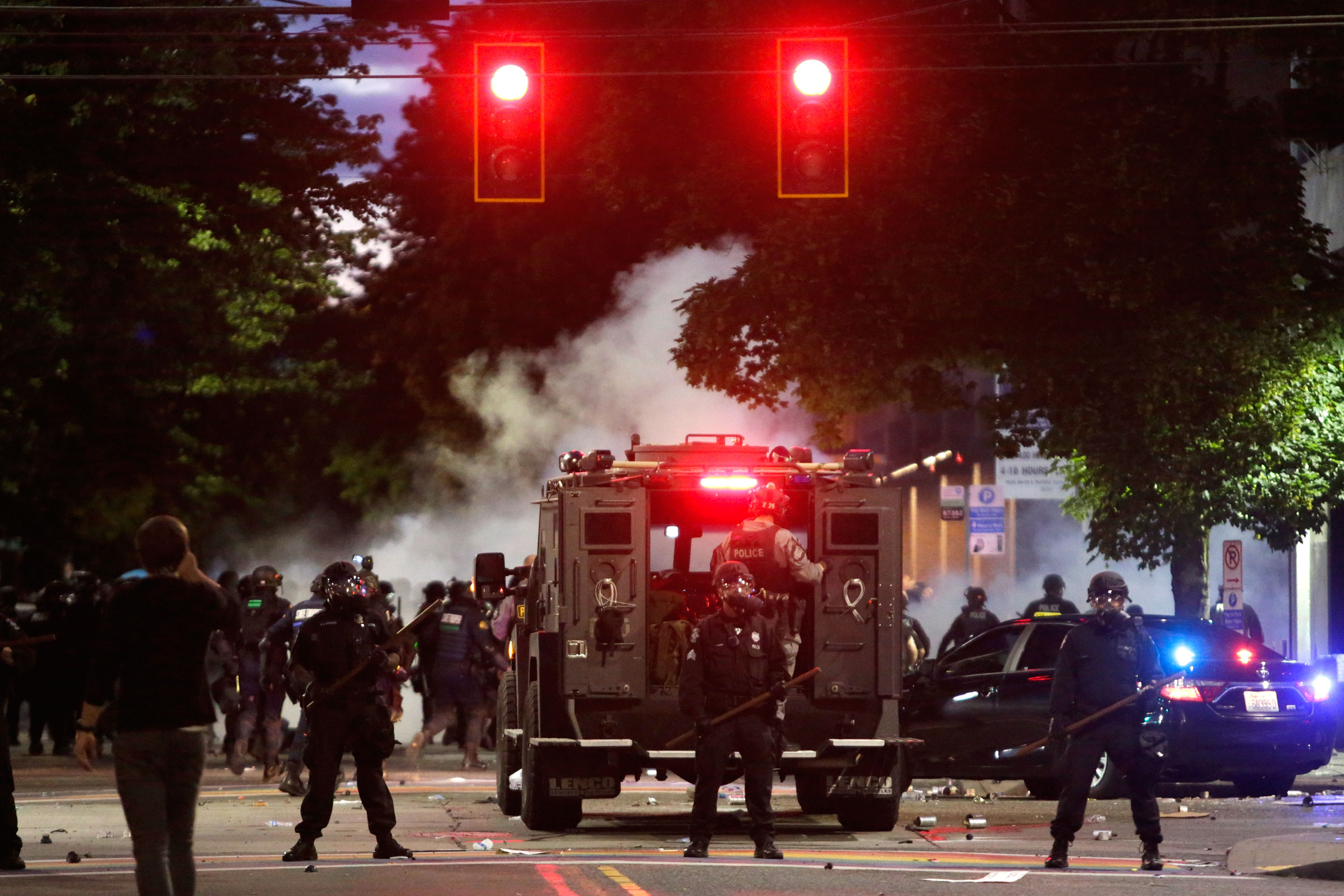 Police patrol after dispersing a protest on Monday night in Seattle.