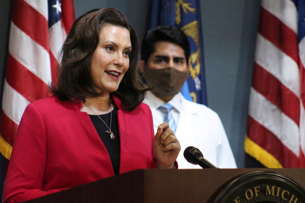 In this Thursday, May 21, 2020 photo provided by the Michigan Office of the Governor, Michigan Gov. Gretchen Whitmer speeks during a news conference in Lansing, Michigan.