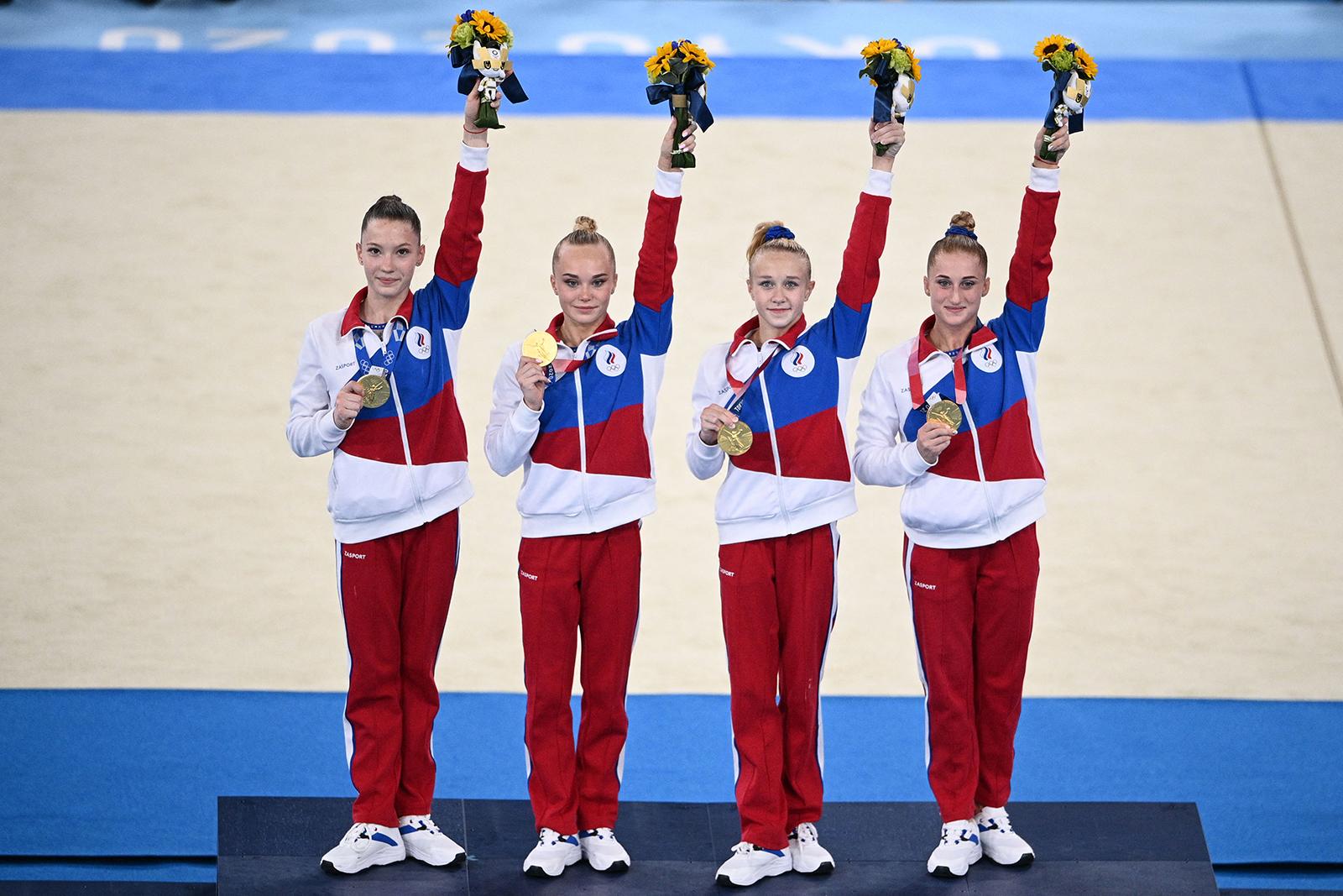 Russia's Liliia Akhaimova, Angelina Melnikova, Viktoriia Listunova and Vladislava Urazova celebrate on the podium after winning the artistic gymnastics women's team final in Tokyo on July 27.