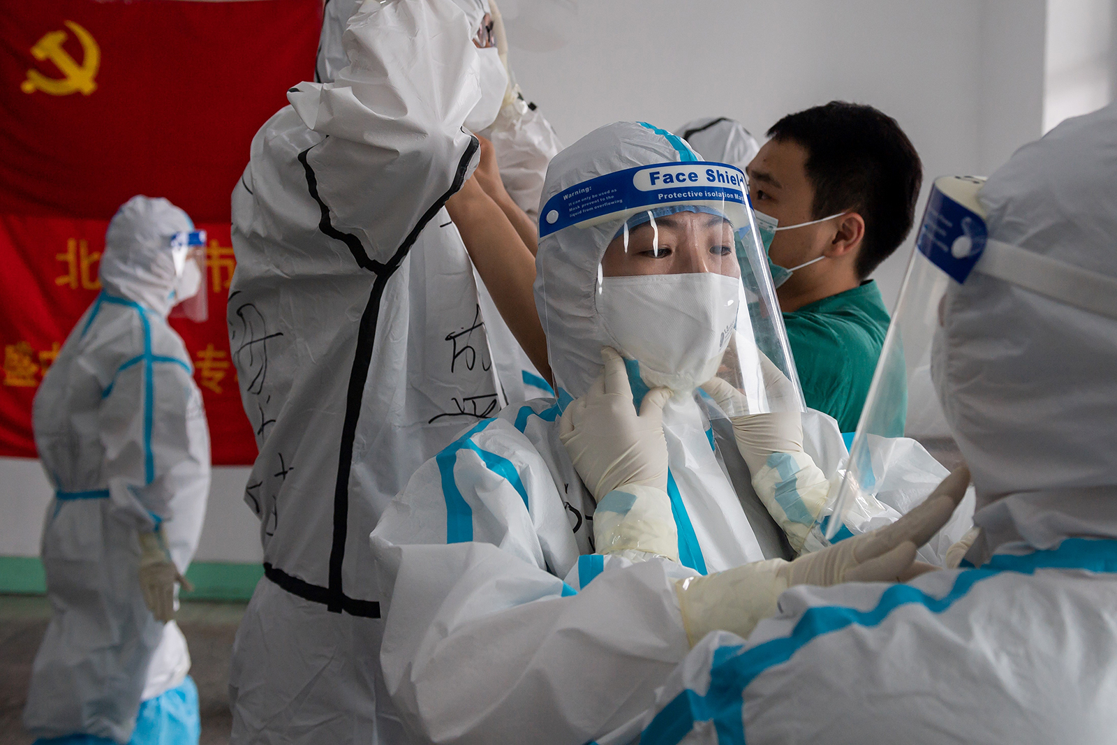 Medics prepare for their shift at the Jinrong Street testing site, in Beijing on June 24.