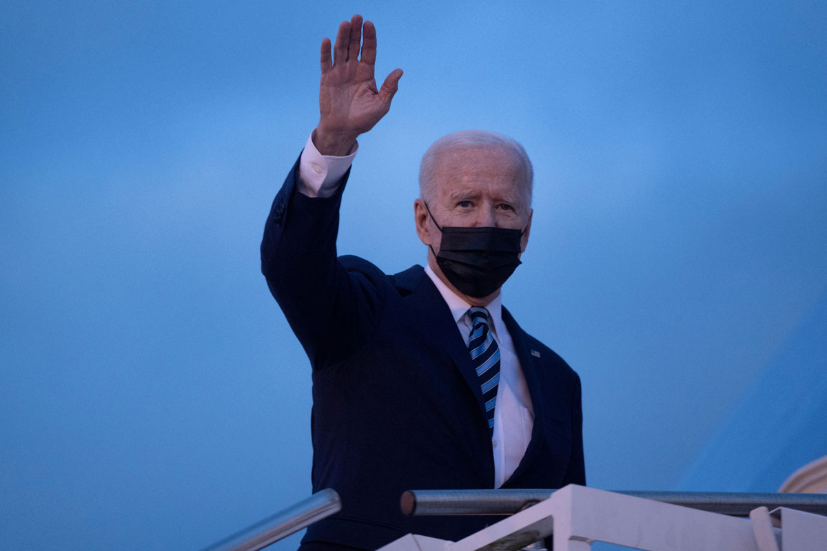 US President Joe Biden waves as he boards Air Force One at Royal Air Force Mildenhall on June 9 en route to Cornwall Airport in Newquay, England.