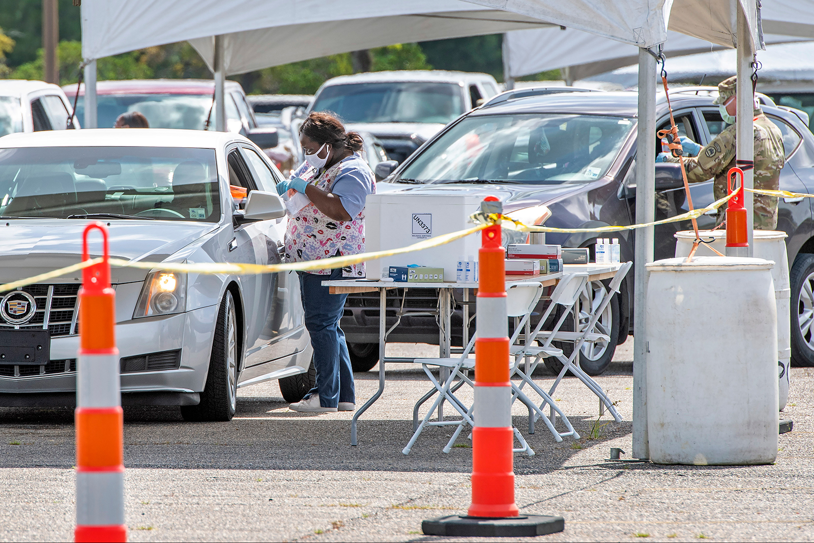 People line up at the Covid-19 testing site at Cortana Mall in Baton Rouge, Louisiana on July 7.