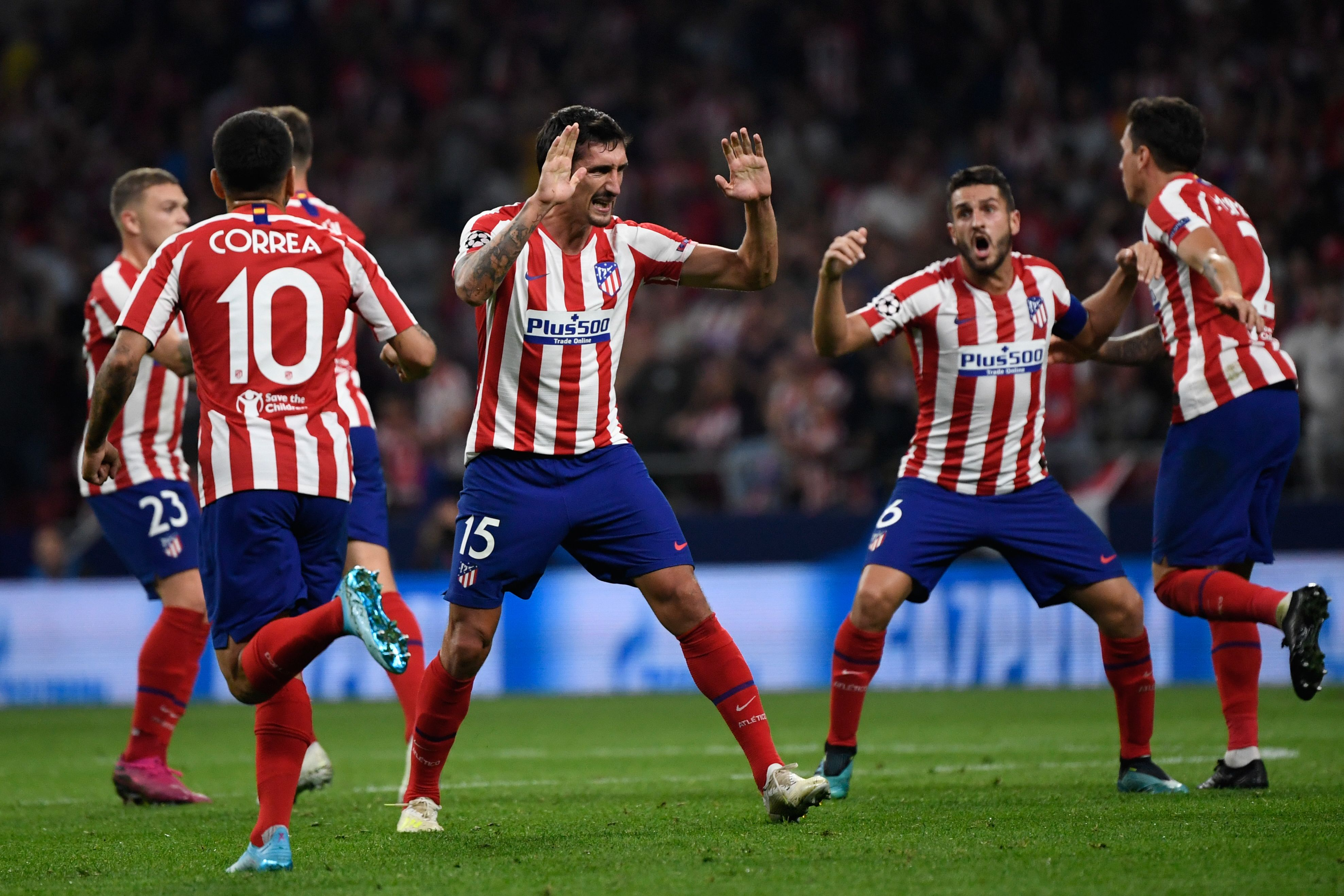 Atletico players celebrate Stefan Savic's goal.